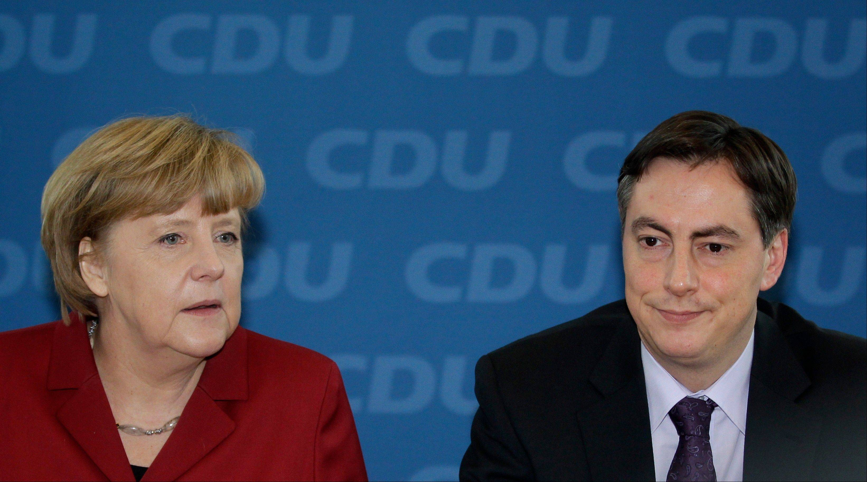German Chancellor and chairwoman of the German Christian Democrats, CDU, Angela Merkel, left, and the CDU top candidate of the Lower Saxony state elections, David McAllister, right.