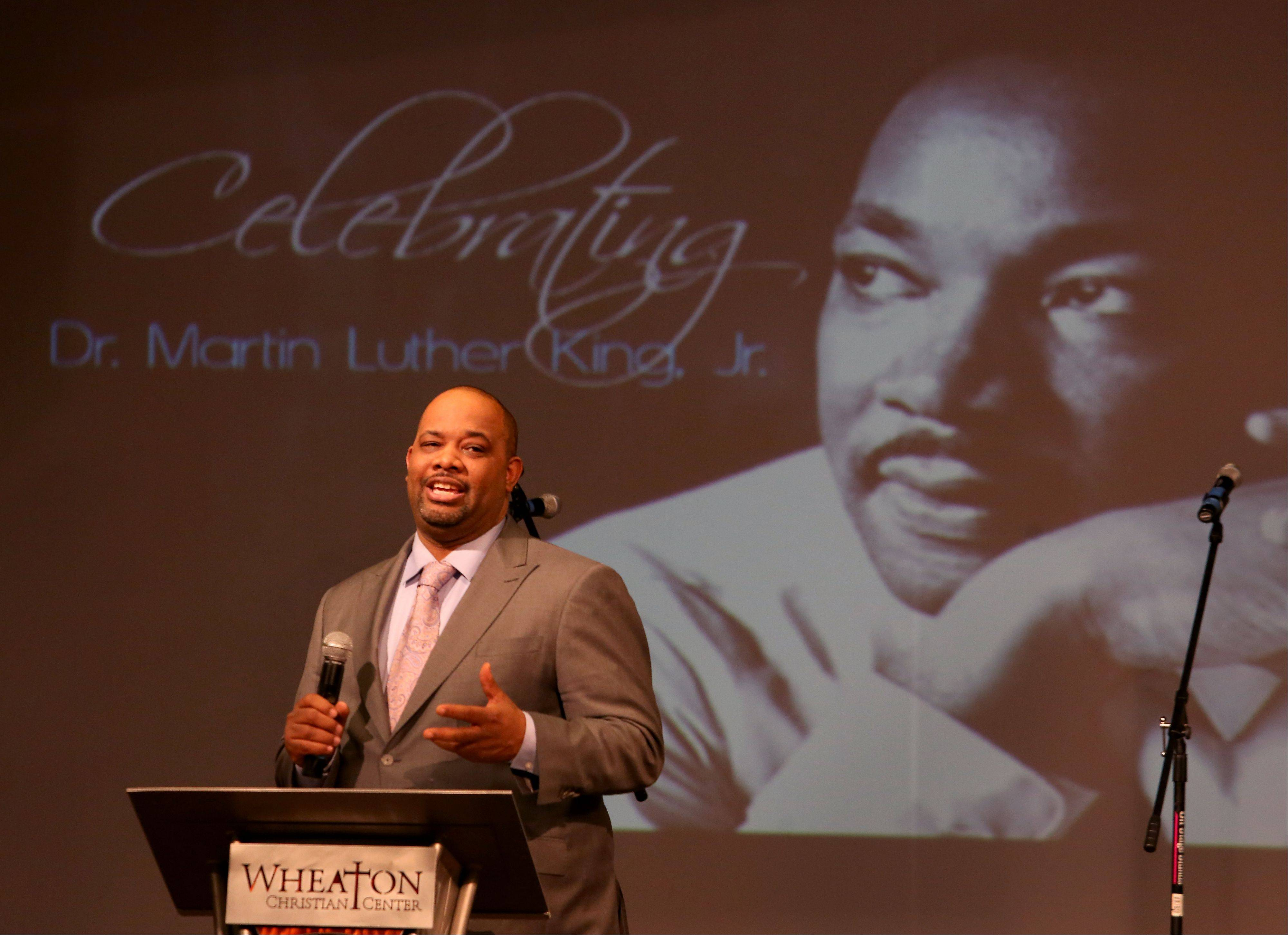 Pastor Corey Brooks from New Beginnings Church in Chicago speaks Monday at the Martin Luther King Jr. Day celebration at the Wheaton Christian Center in Carol Stream.