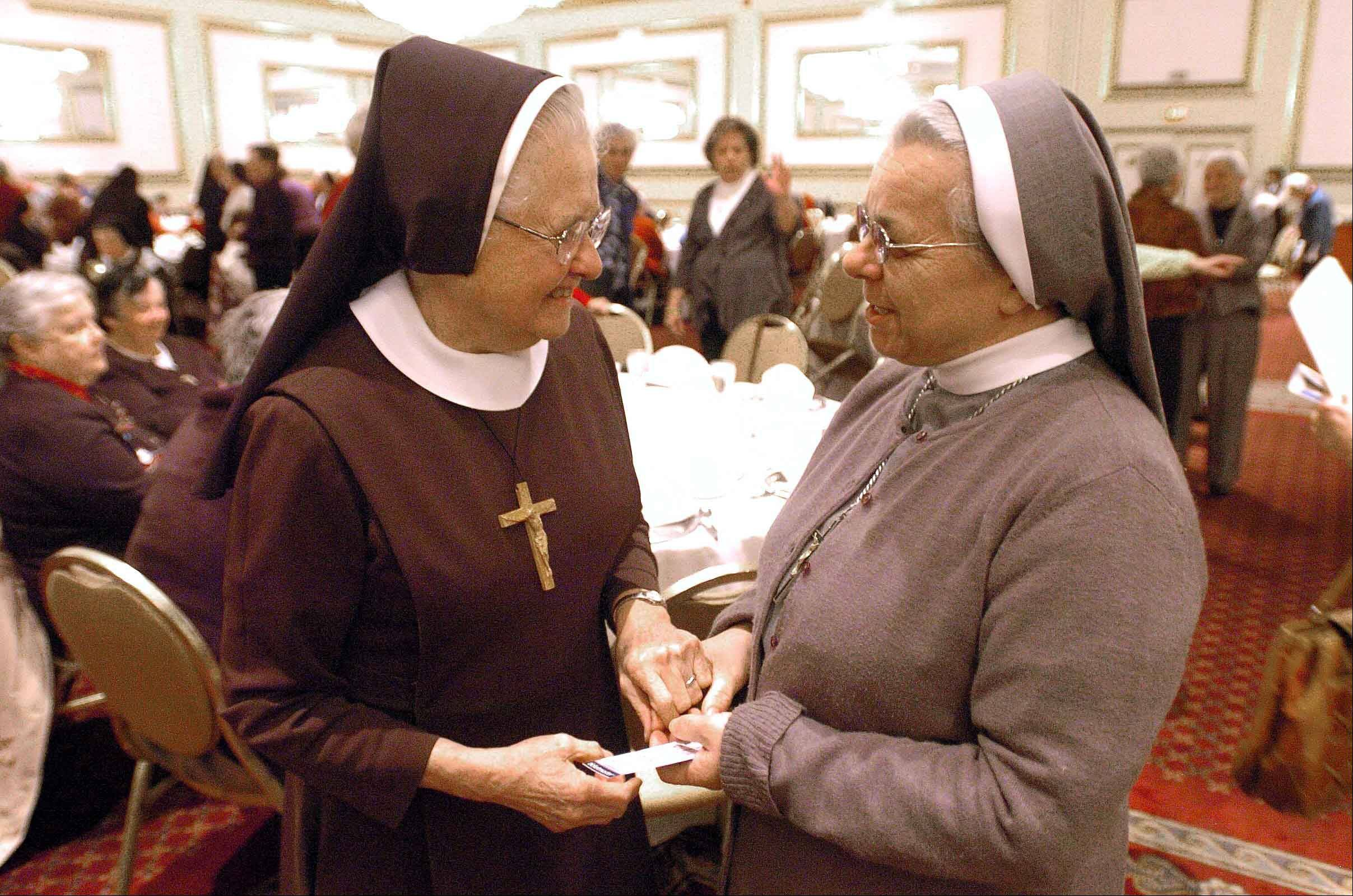 "Sister Mary Lucia, left, and Sister Gloria, both of Chicago, chat at Drury Lane Theatre in Oakbrook Terrace before a performance of ""The Sound of Music"" in January 2012."
