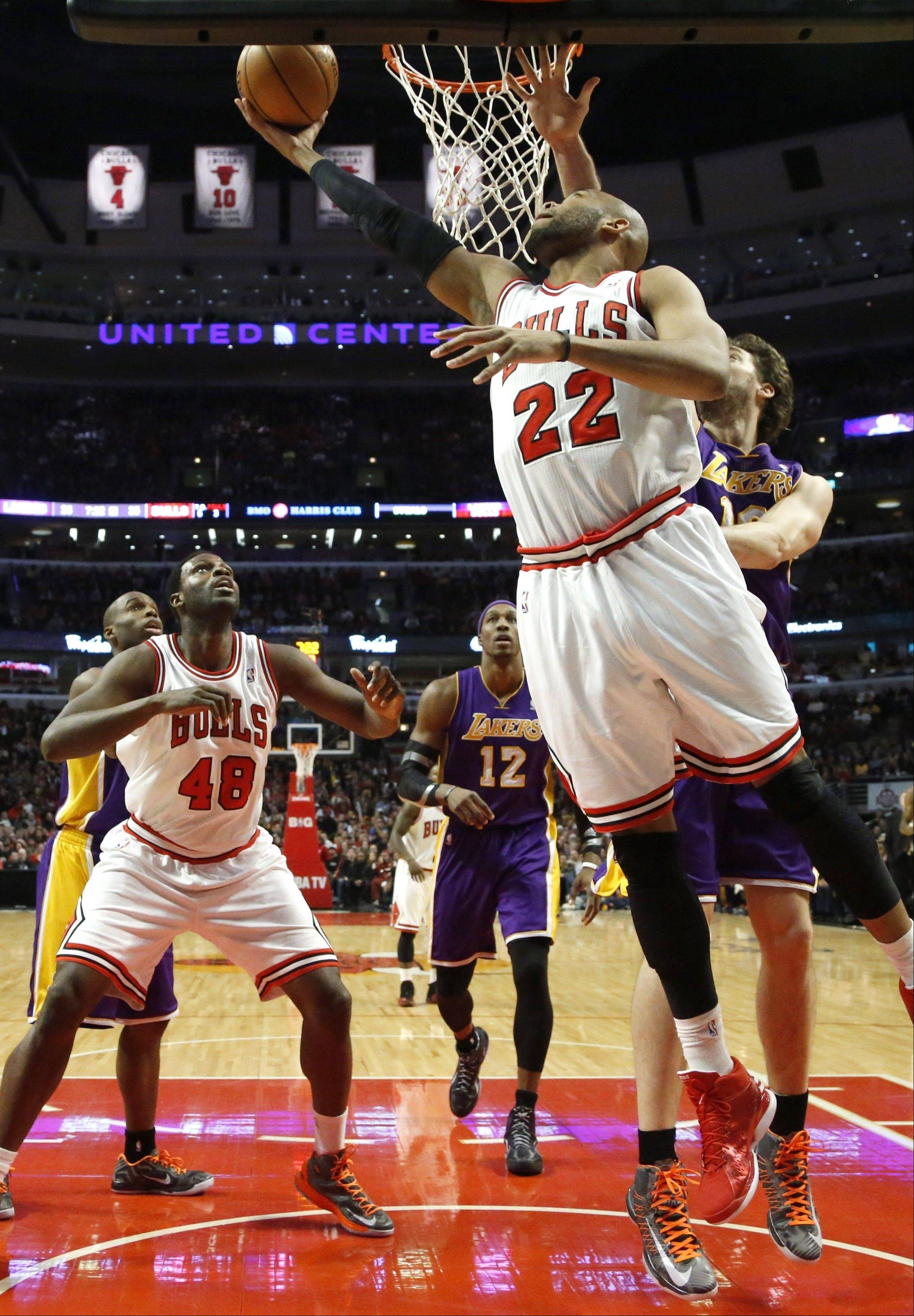 Bulls forward Taj Gibson shoots a reverse layup past the Lakers� Pau Gasol on Monday night at the United Center.