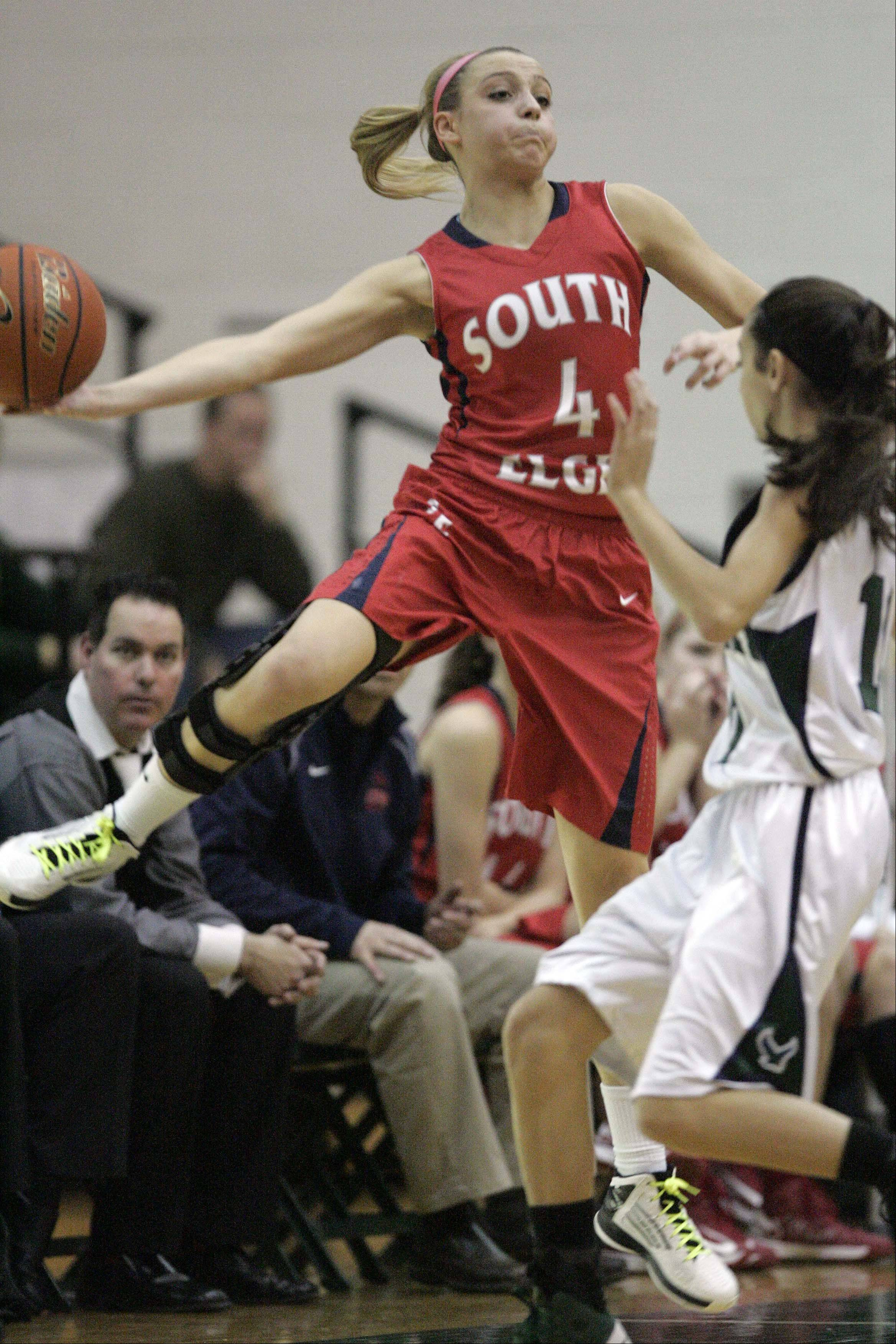South Elgin junior Savanah Uveges (4) leaps out of bounds as she tries to save an errant pass during the Storm�s win at Bartlett Saturday.