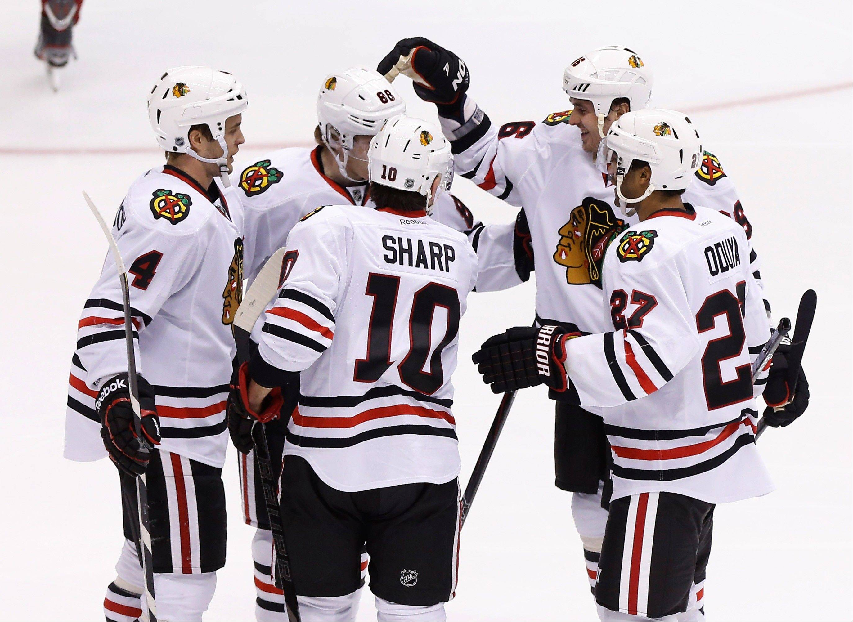 Blackhawks second line center Dave Bolland, right, celebrates his goal with teammates Johnny Oduya (27), Patrick Sharp (10), Niklas Hjalmarsson (4), and Patrick Kane (88) during Sunday�s 6-4 win at Phoenix.