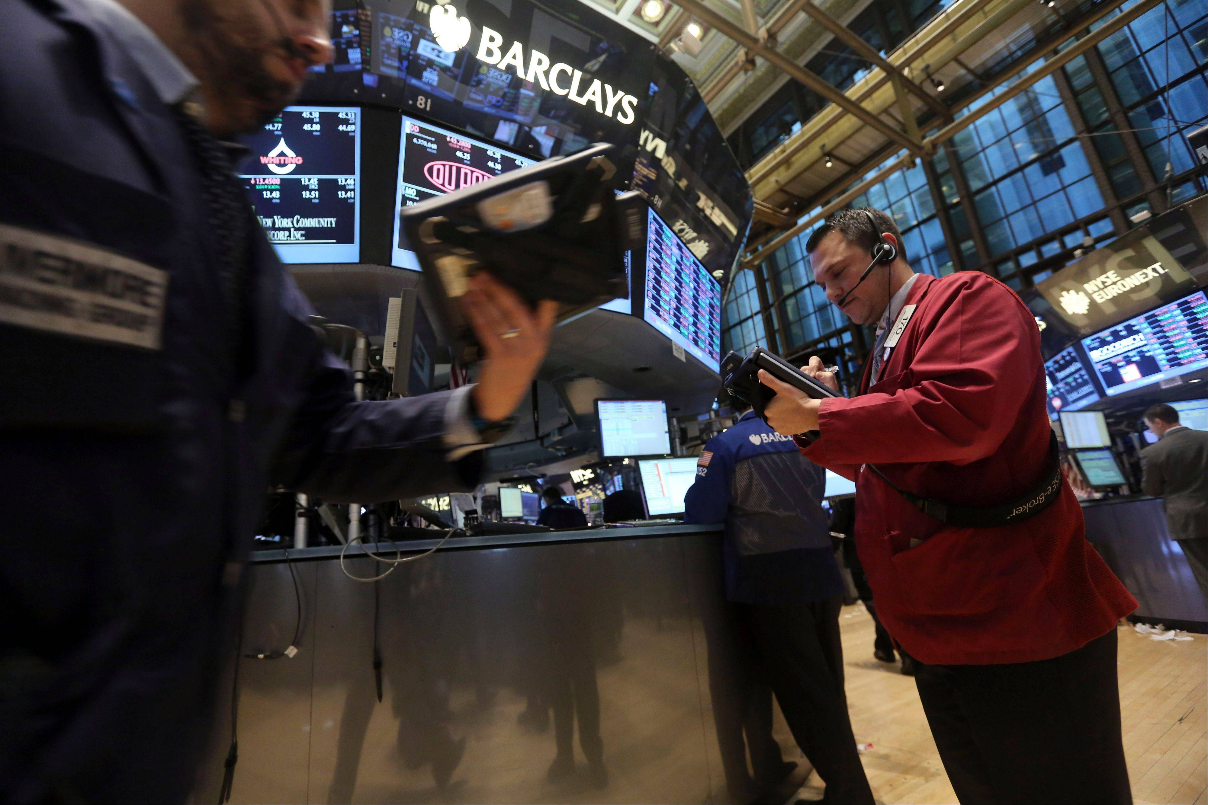 Associated Press  Traders work on the floor of the New York Stock Exchange.