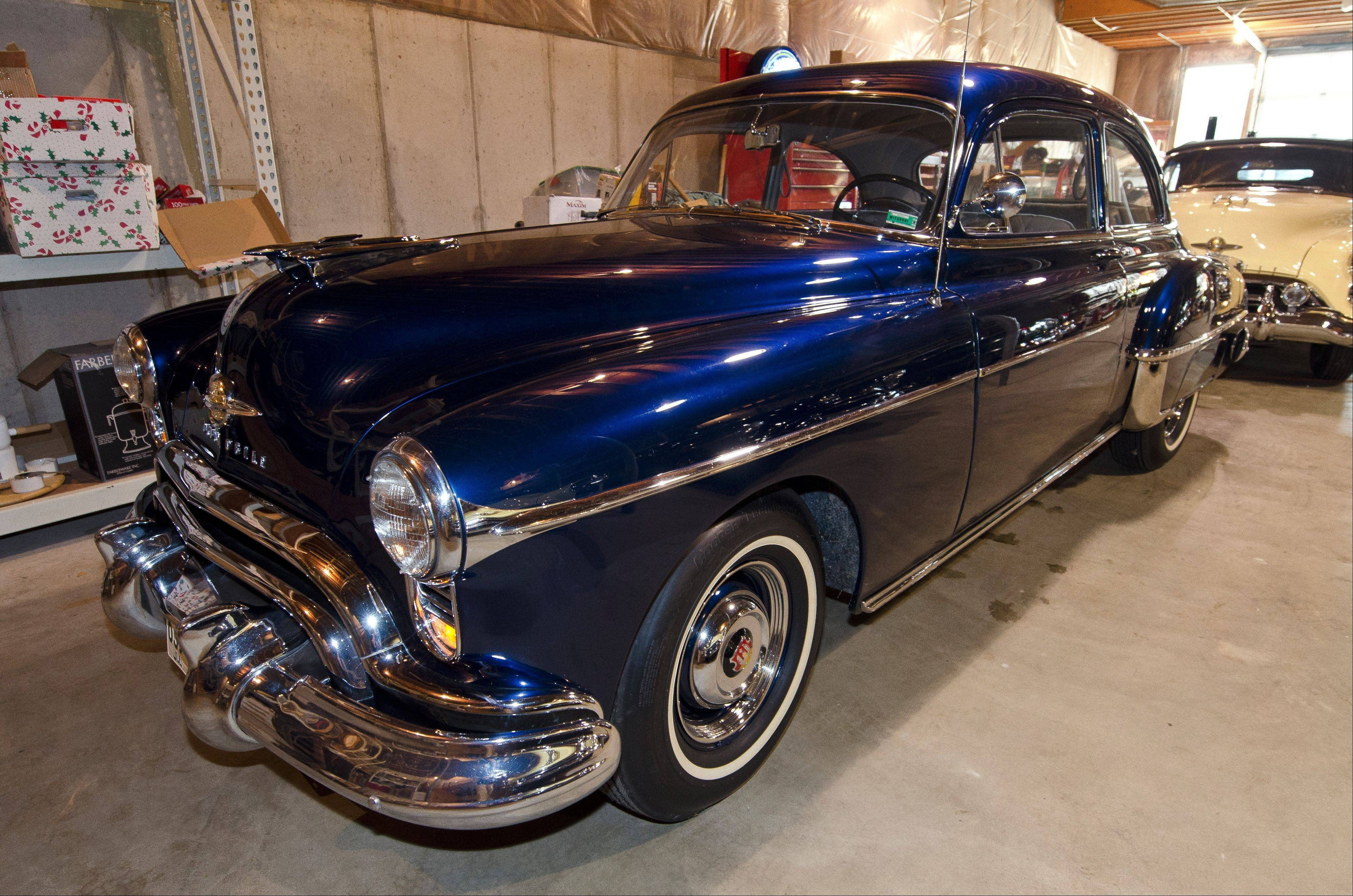 This 1950 88 is nearly identical to Albrecht's first Oldsmobile. He used a modern Toyota color to match the original Surge Blue paint.