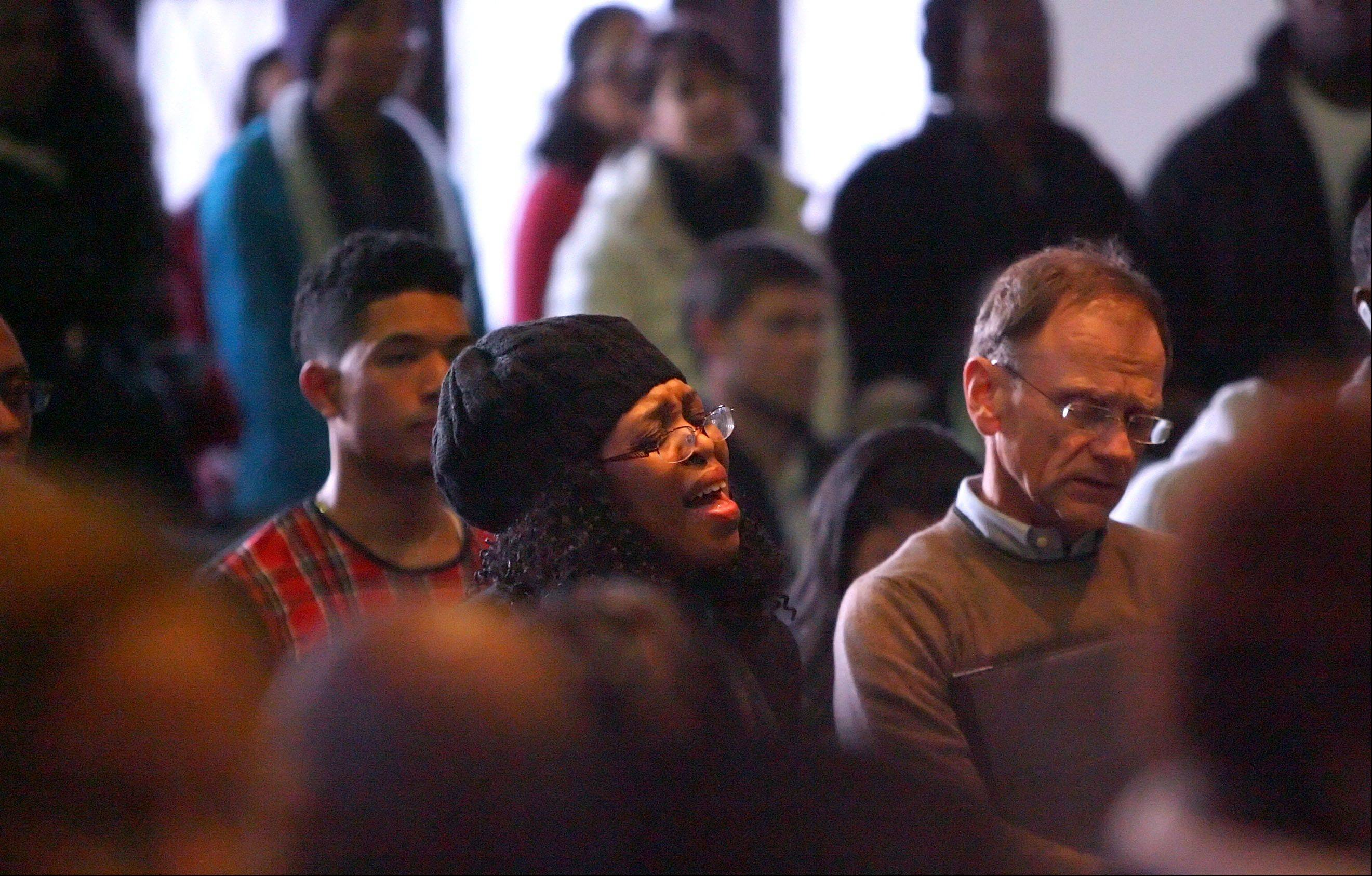 Audience members sing the Negro national anthem during Lake Forest College's annual Martin Luther King Jr. program at Lily Reid Holt Memorial Chapel Monday.