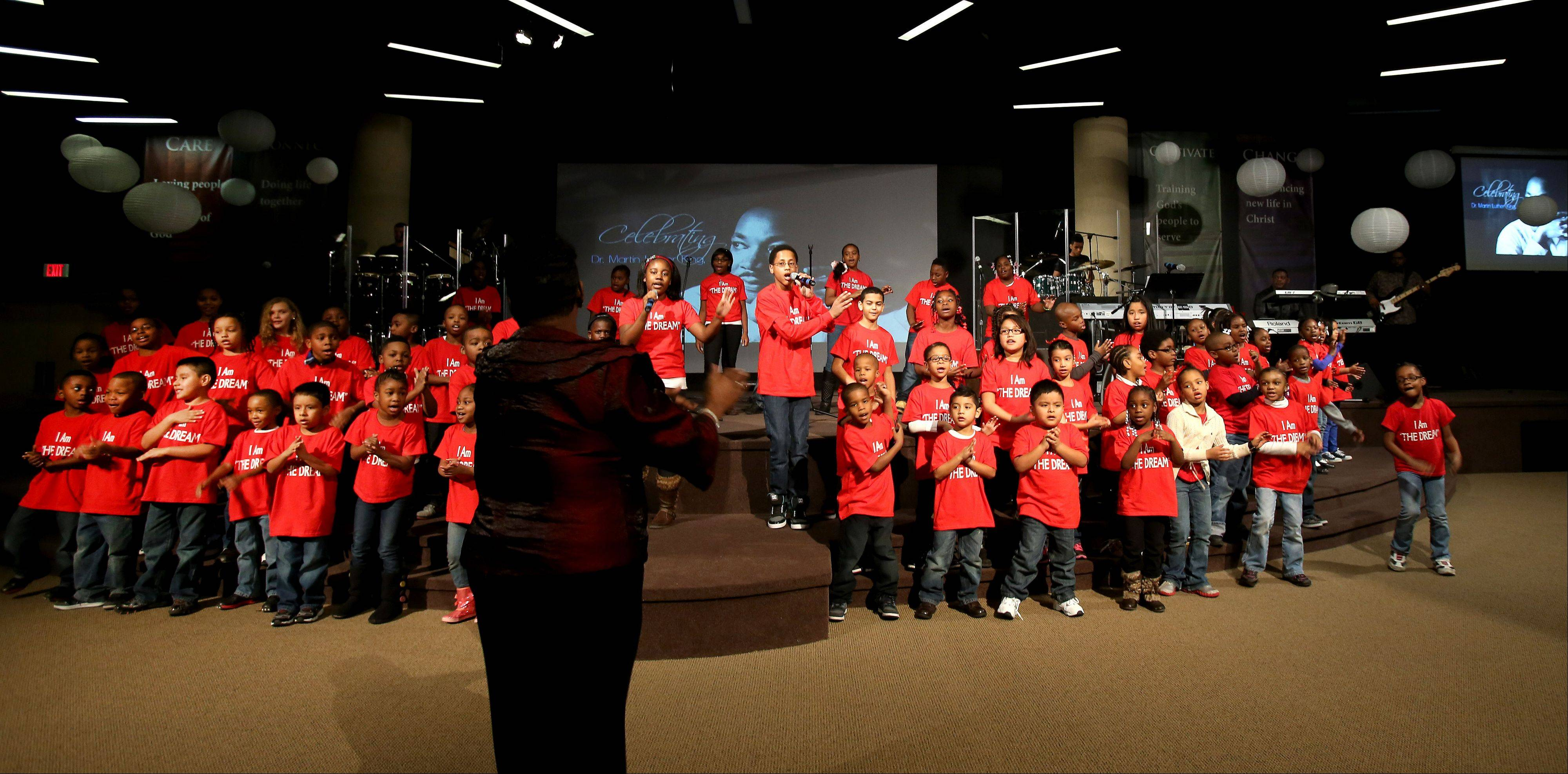 Kids making up the Carol Stream Community Choir perform at the Martin Luther King Jr. Day celebration at the Wheaton Christian Center in Carol Stream on Monday.