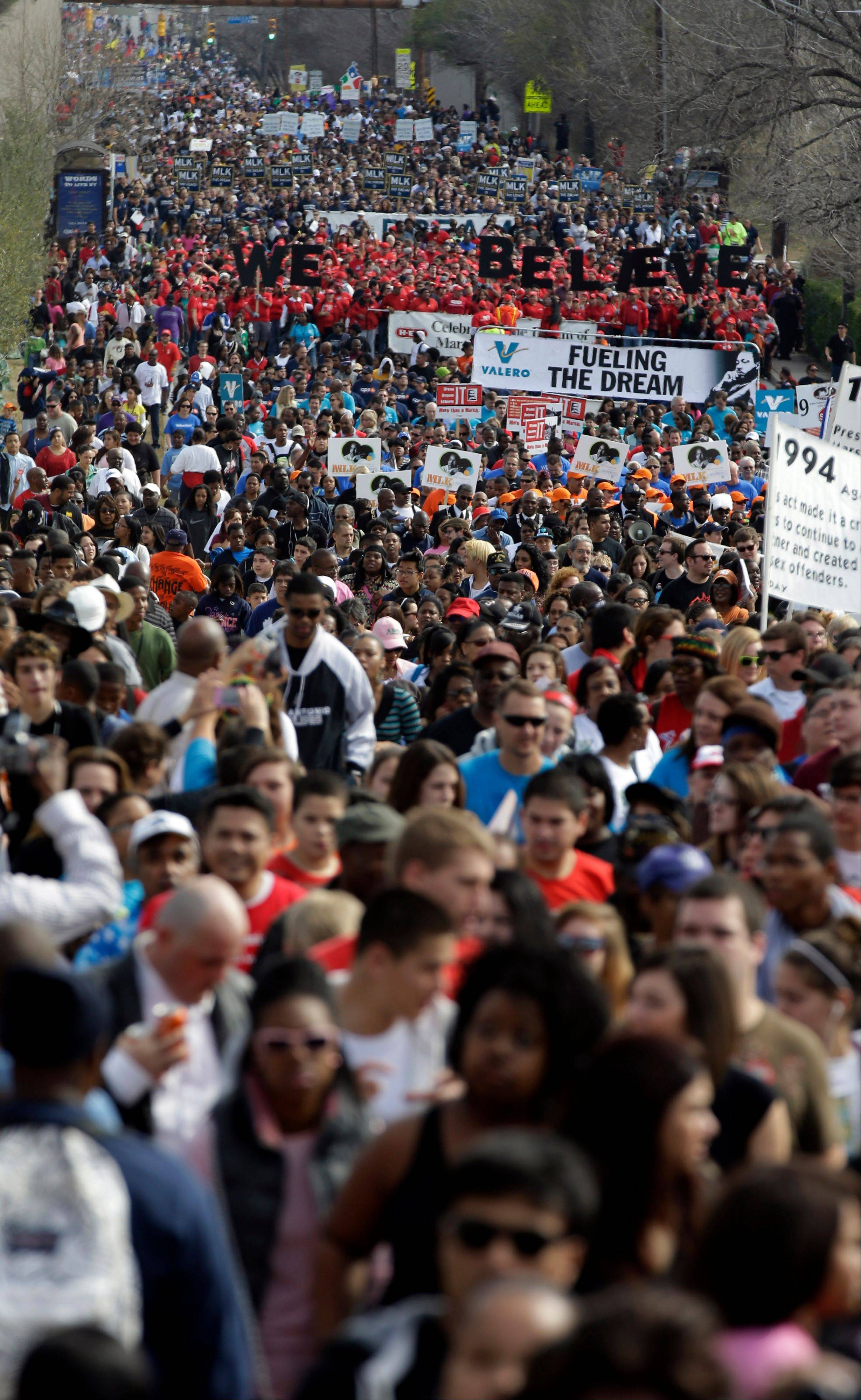 Thousands take part in a march honoring Martin Luther King Jr., Monday, Jan. 21, 2013, in San Antonio.