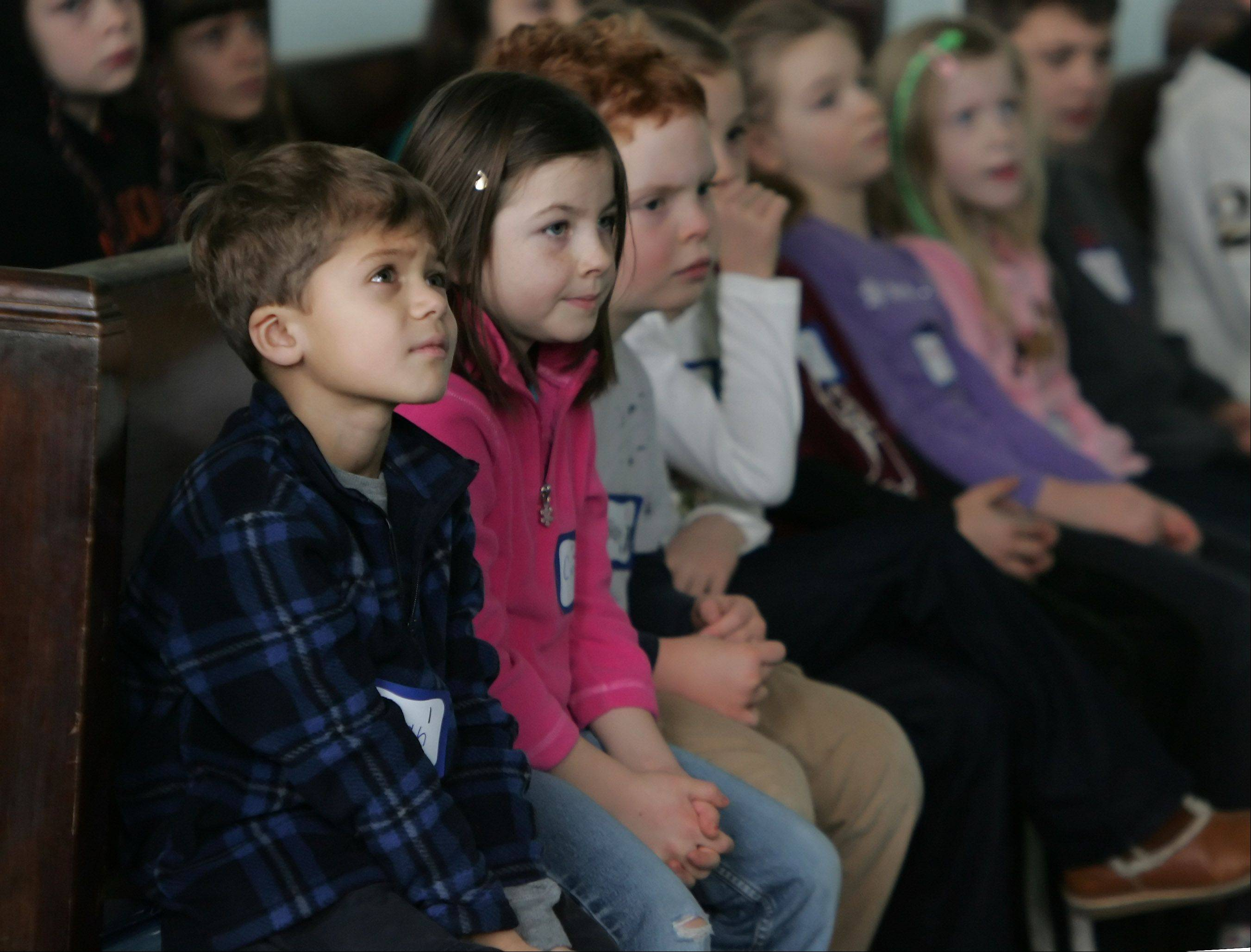 "Children listen to Rev. Amy Heinrich quote from the ""I Have a Dream"" speech by Martin Luther King, Jr. during the Hearts the Same program Monday at the First Presbyterian Church of Libertyville."
