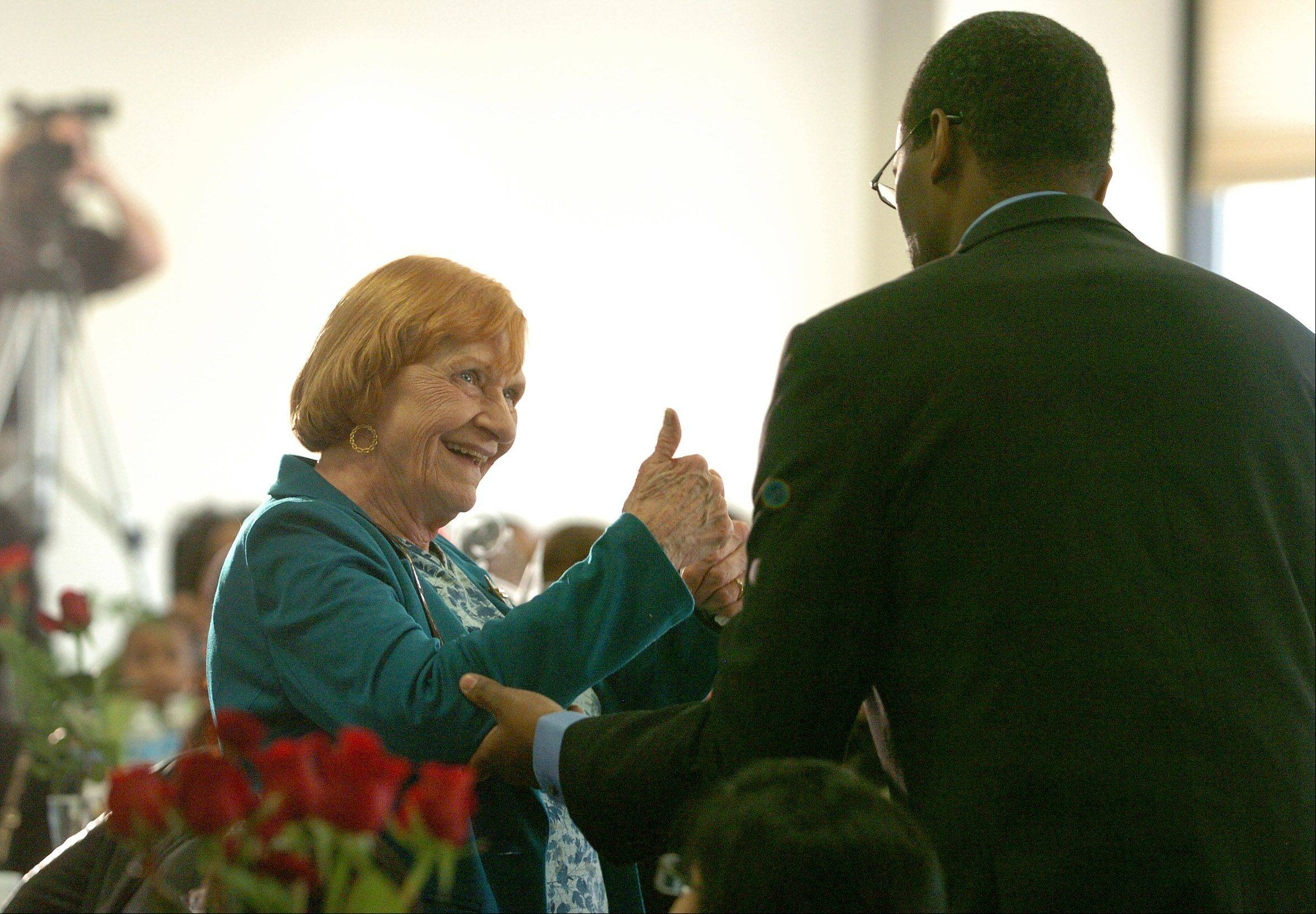 Joan Jarzemsky gives a thumbs-up to professor DuBoi McCarty of Harper College Monday morning.
