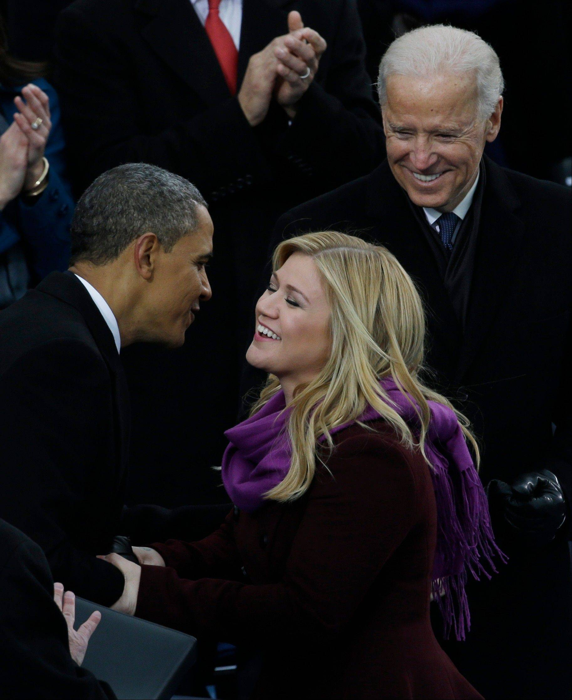 President Barack Obama shakes hands with Kelly Clarkson at the ceremonial swearing-in at the U.S. Capitol during the 57th Presidential Inauguration in Washington, Monday, Jan. 21, 2013.