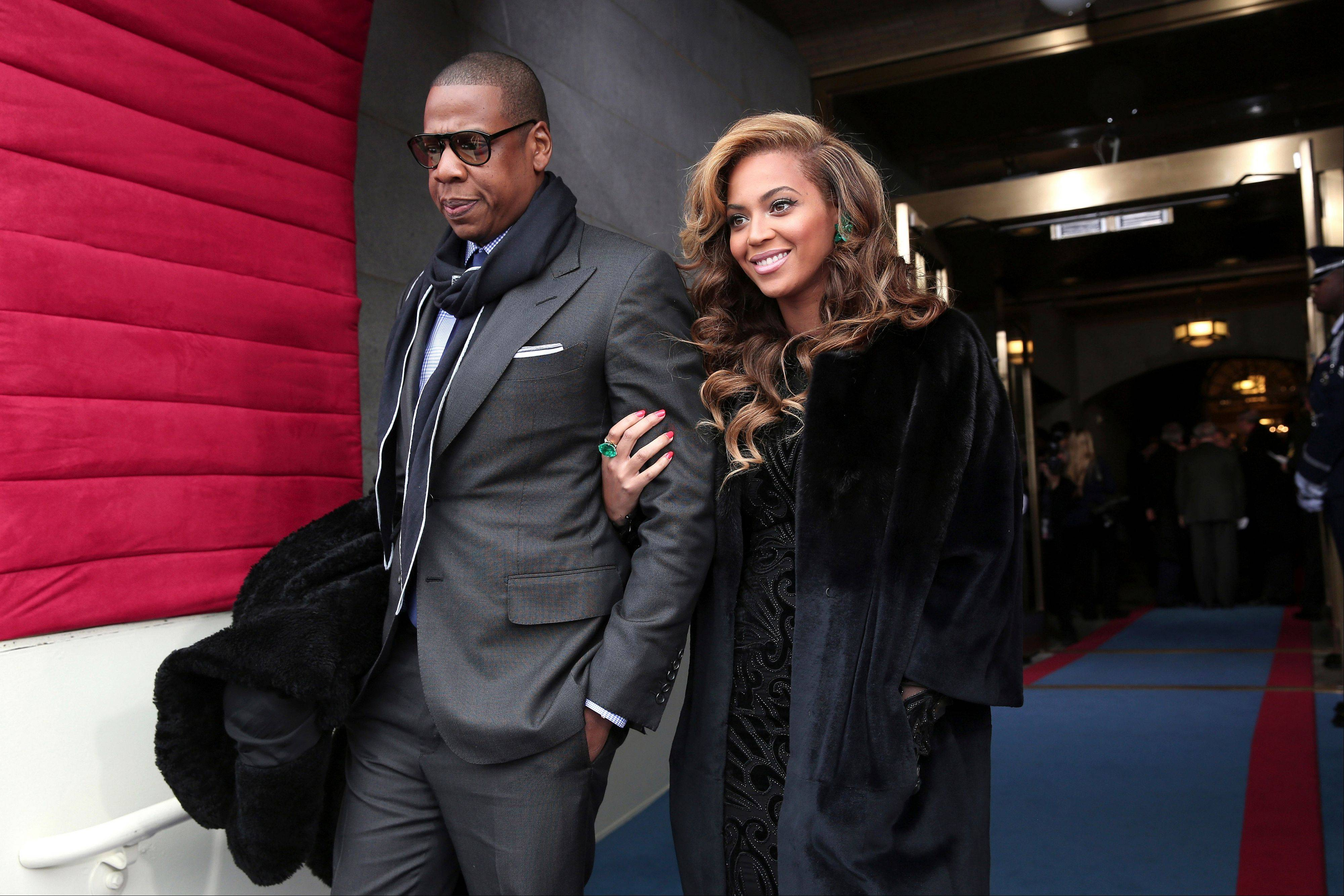 Recording artists Jay-Z and Beyonce arrive on the West Front of the Capitol in Washington, Monday, Jan. 21, 2013, for the Presidential Barack Obama's ceremonial swearing-in ceremony during the 57th Presidential Inauguration.