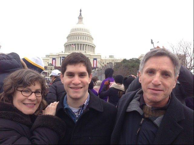Lauren Beth Gash of Highland Park attends the inauguration with her son Ben Garmisa, center, and husband Gregg Garmisa, right.