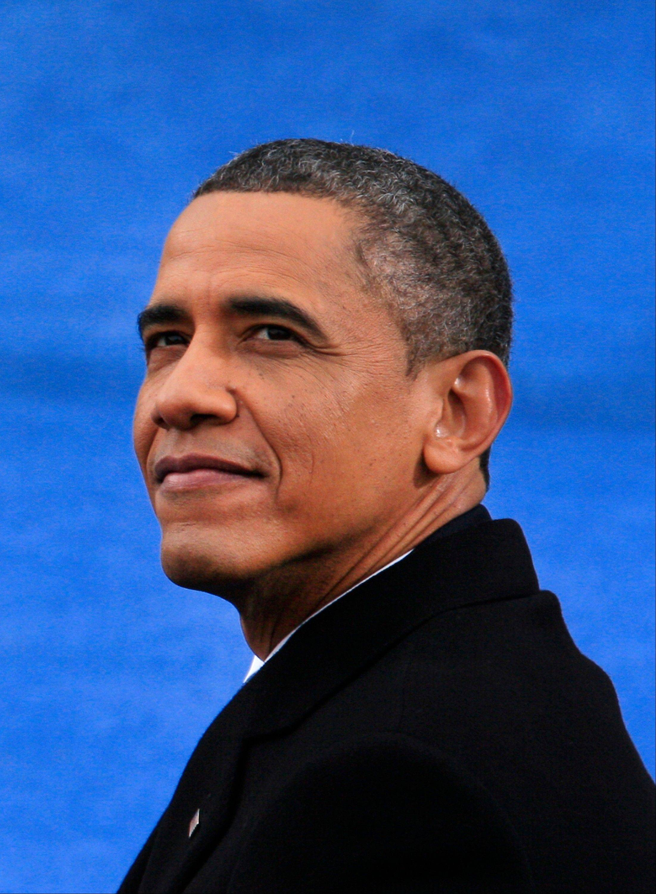 U.S. President Barack Obama looks on during the presidential inauguration in Washington, D.C., U.S., on Monday, Jan. 21, 2013. A