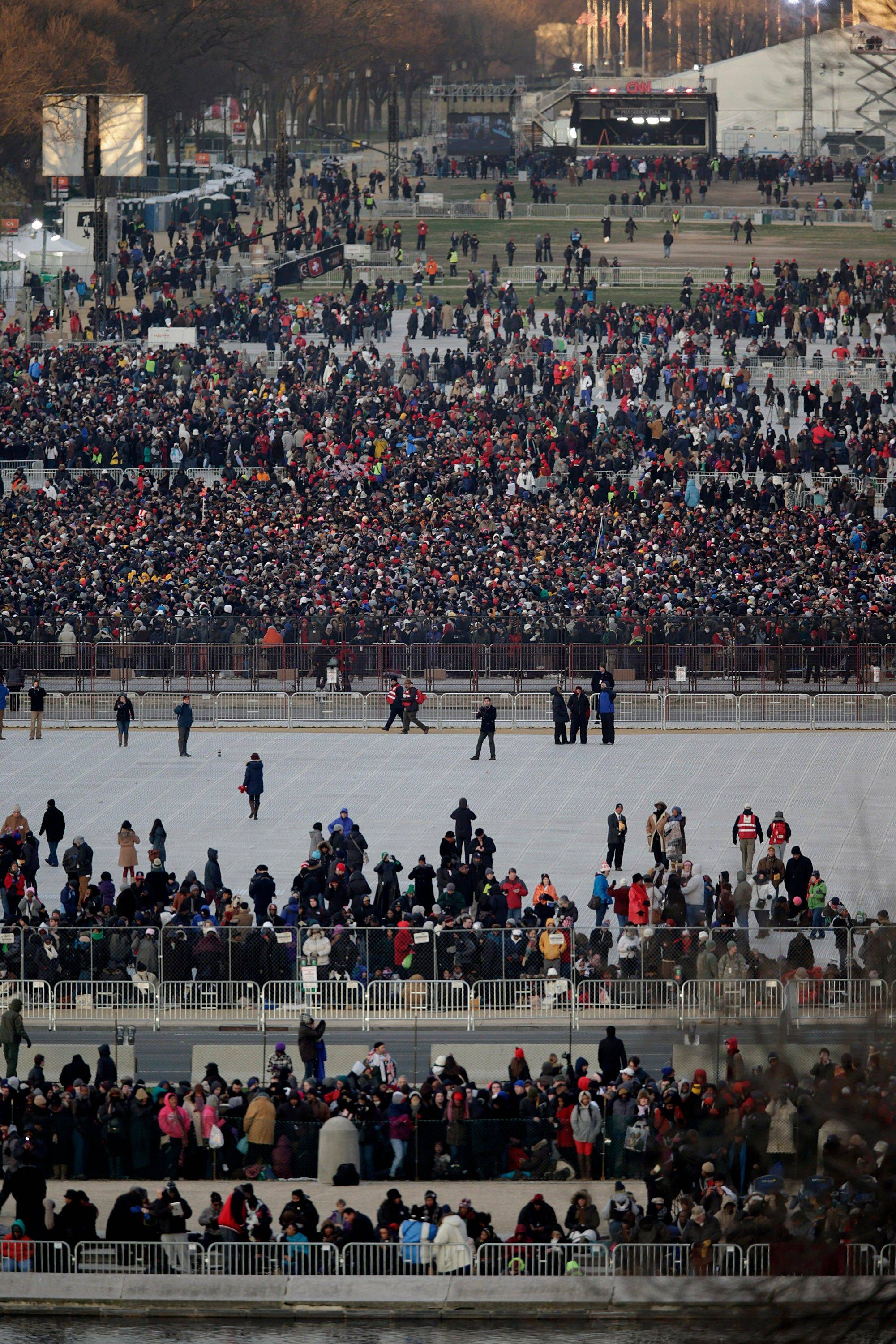 People gather on the National Mall during the U.S. presidential inauguration in Washington, D.C., U.S., on Monday, Jan. 21, 2013.