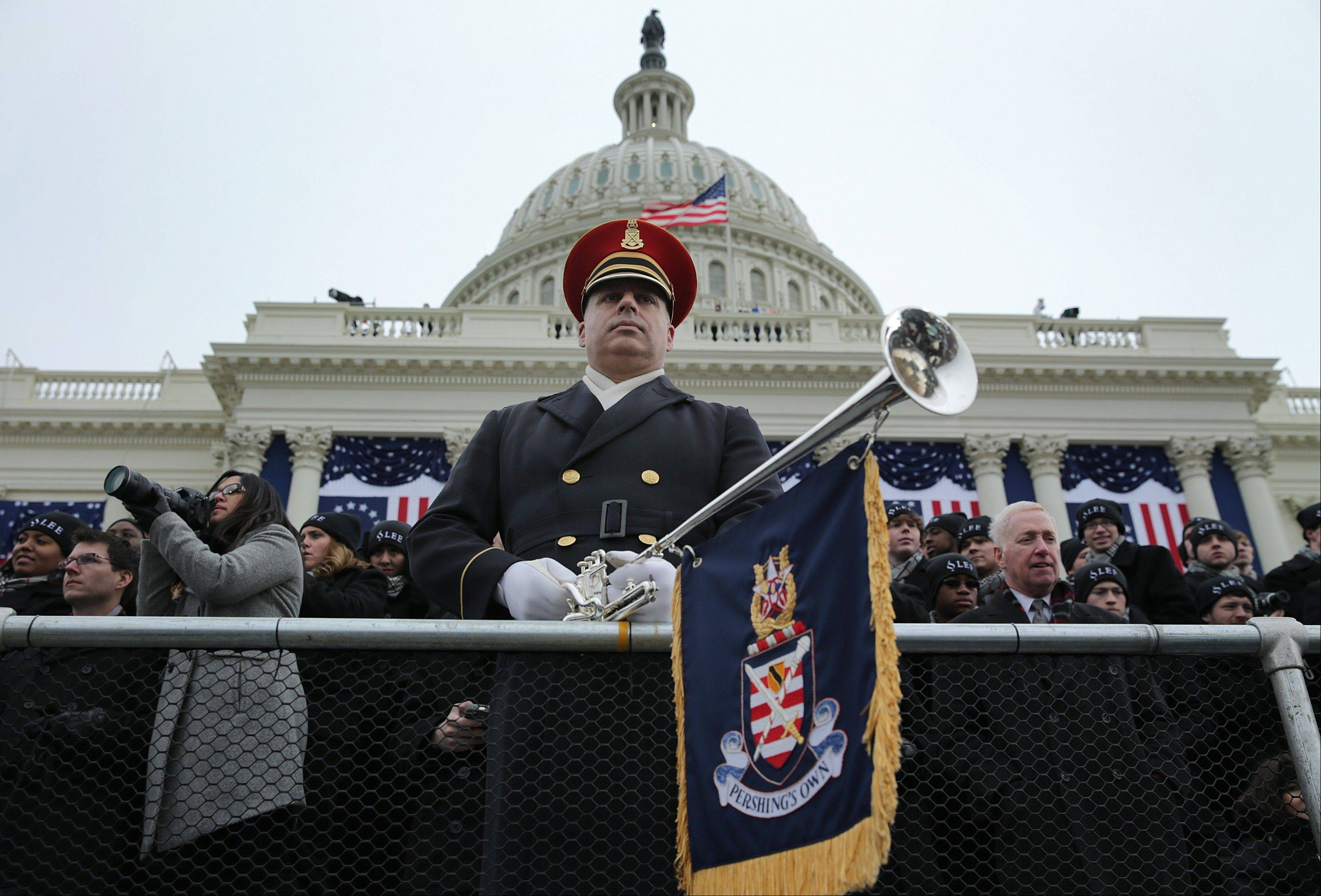 "A member of the U.S. Army Band ""Pershing's Own"" stands during the presidential inauguration in Washington, D.C., U.S., on Monday, Jan. 21, 2013."