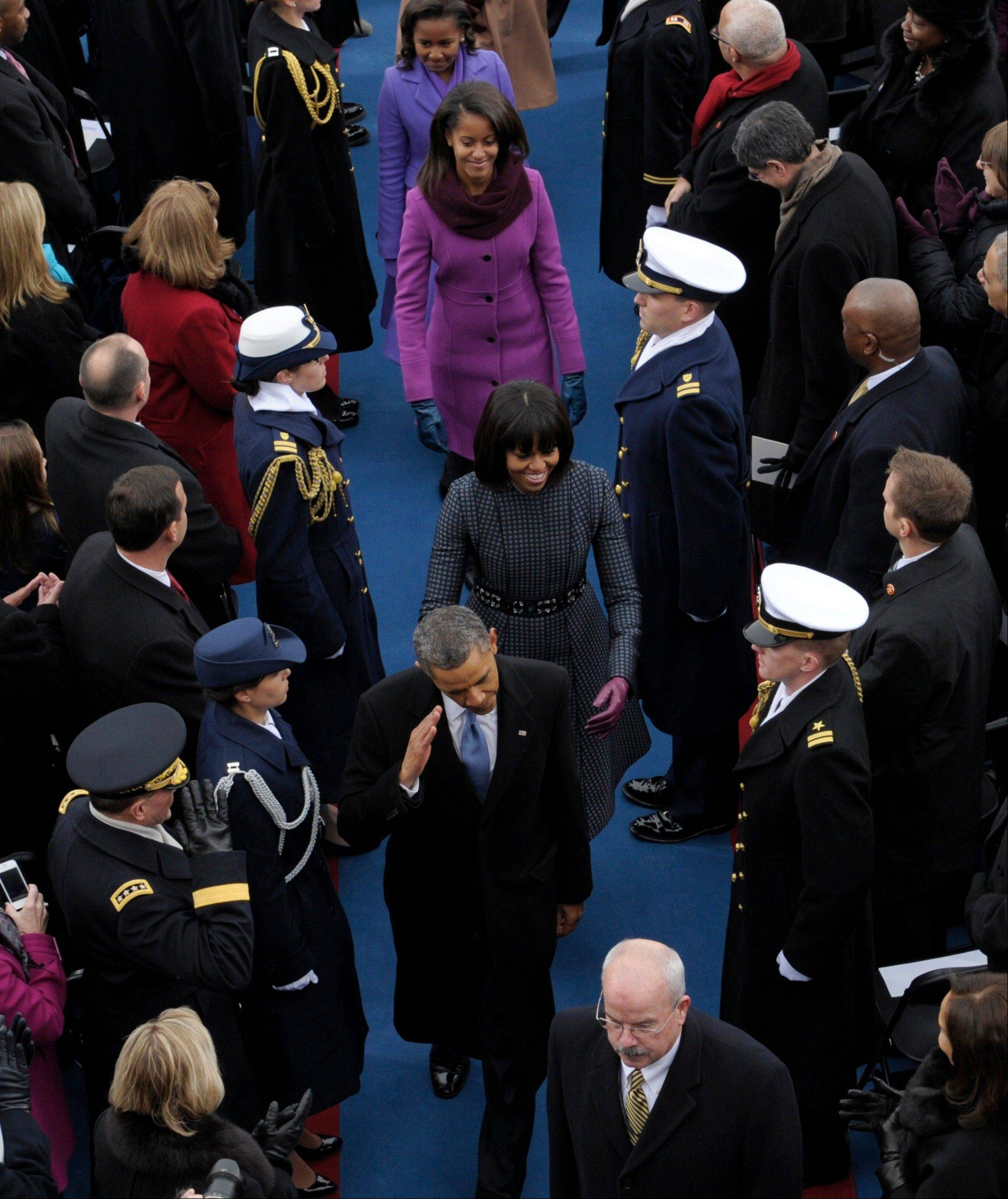 President Barack Obama salutes as he leaves with his family following the ceremonial swearing-in at the U.S. Capitol during the 57th Presidential Inauguration in Washington, Monday, Jan. 21, 2013.