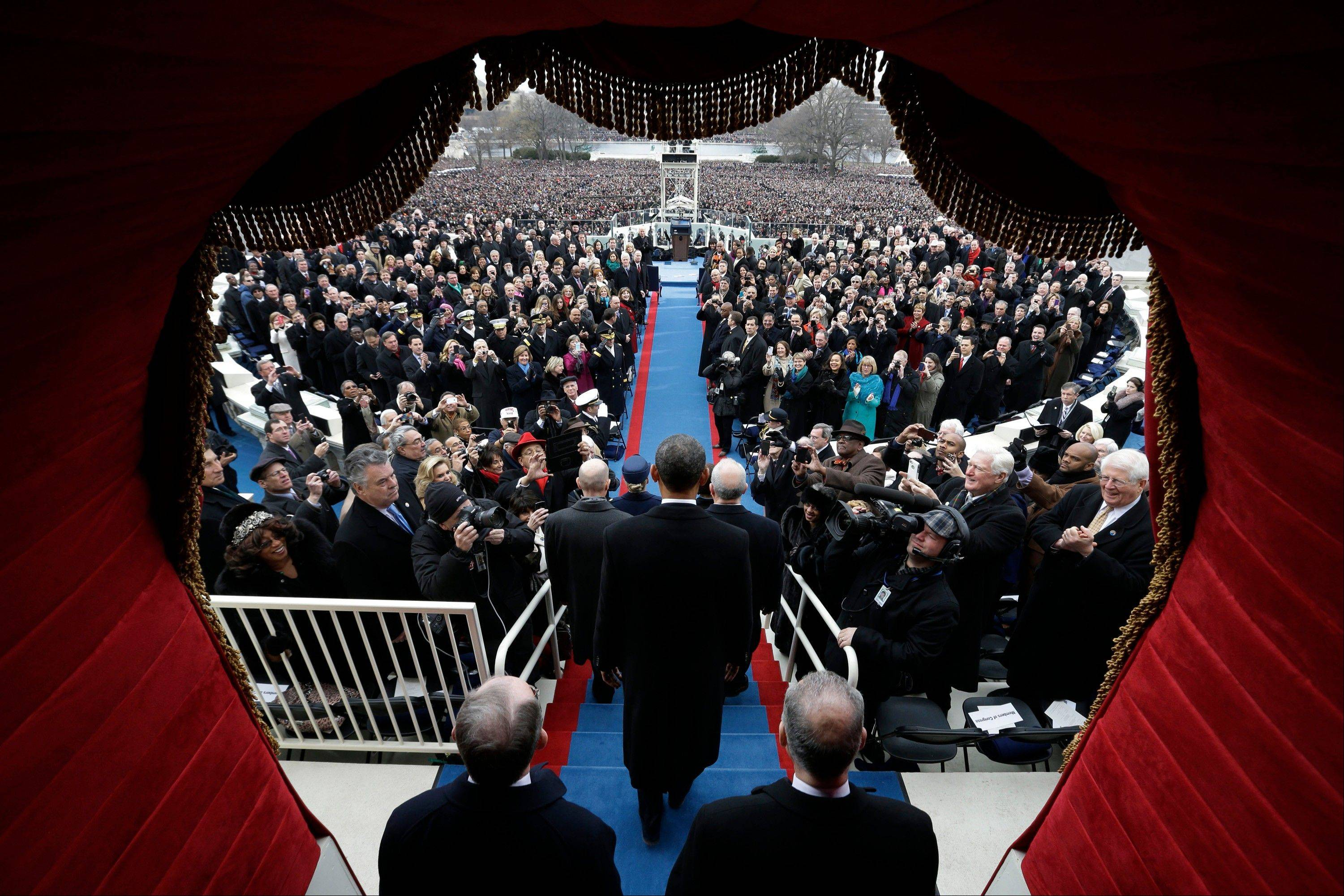 U.S. President Barack Obama arrives for the ceremonial swearing-in at the Capitol during the U.S. presidential inauguration in Washington, D.C., U.S., on Monday, Jan. 21, 2013.