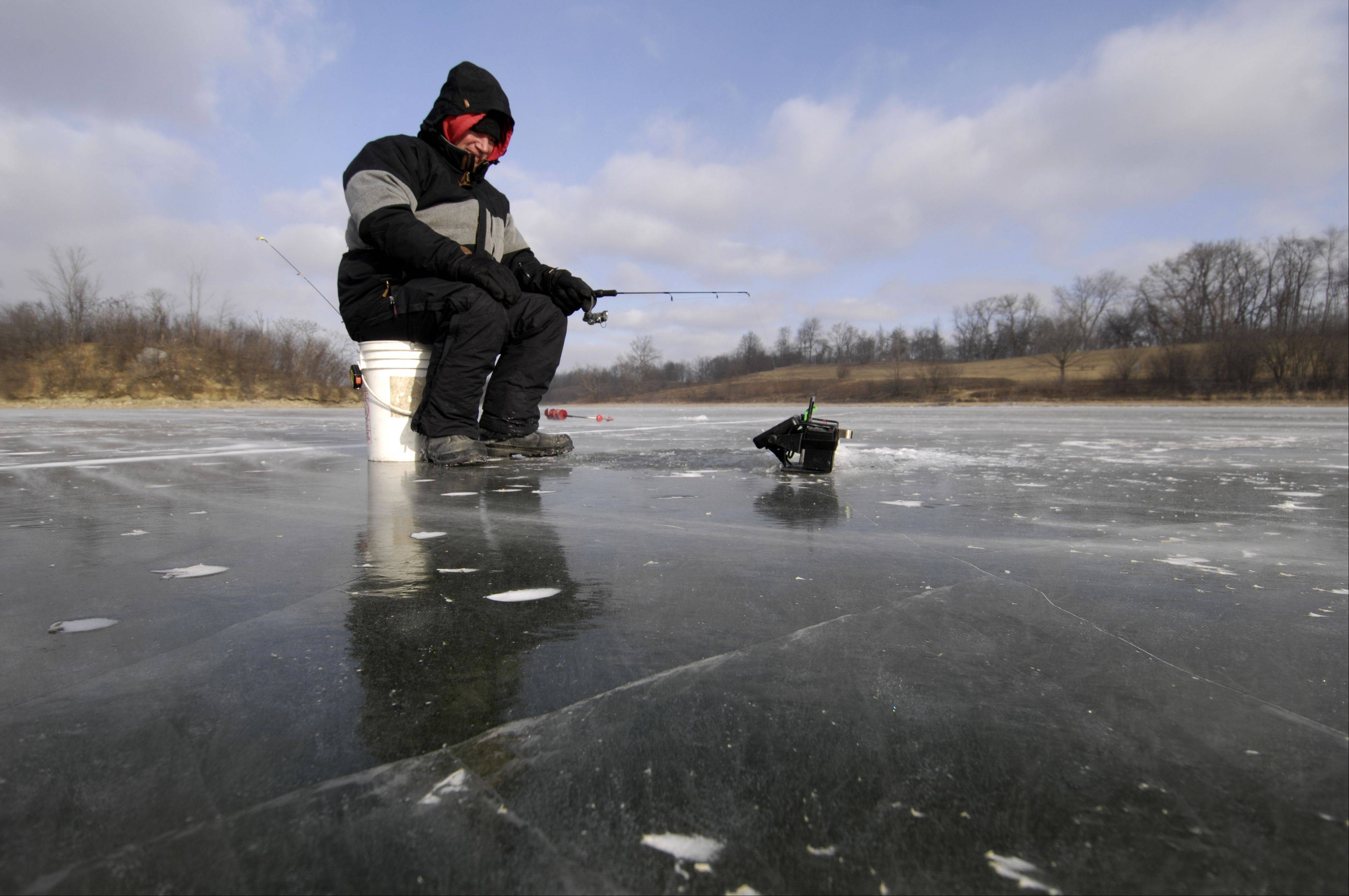 Mark Black/mblack@dailyherald.com Karl Petipren of Naperville braves single digit temperatures to do some ice fishing for walleye at Blackwell Forest Preserve. The ice is about six inches thick.