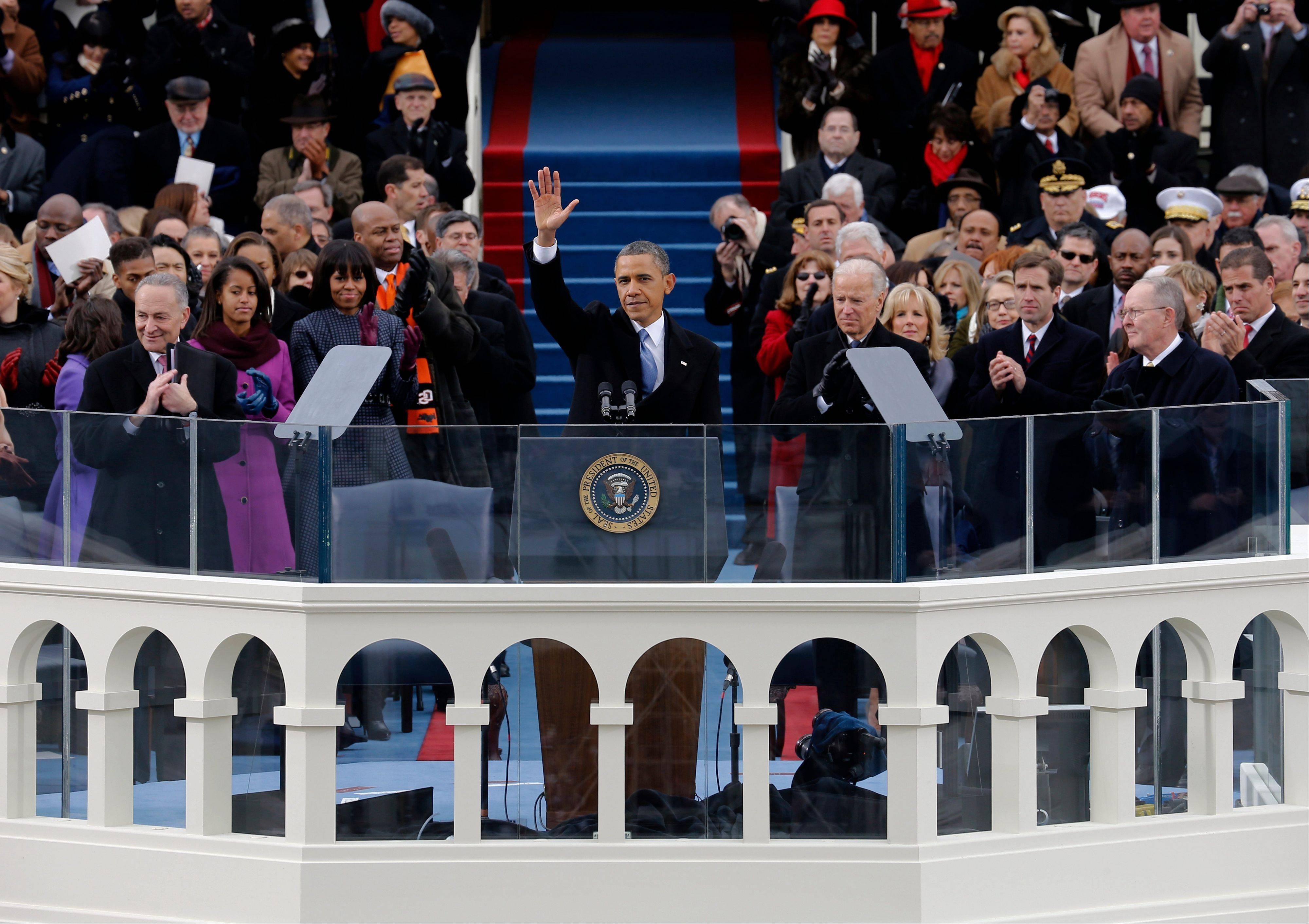 President Barack Obama waves to crowd after his Inaugural speech at the ceremonial swearing-in on the West Front of the U.S. Capitol during the 57th Presidential Inauguration in Washington, Monday.