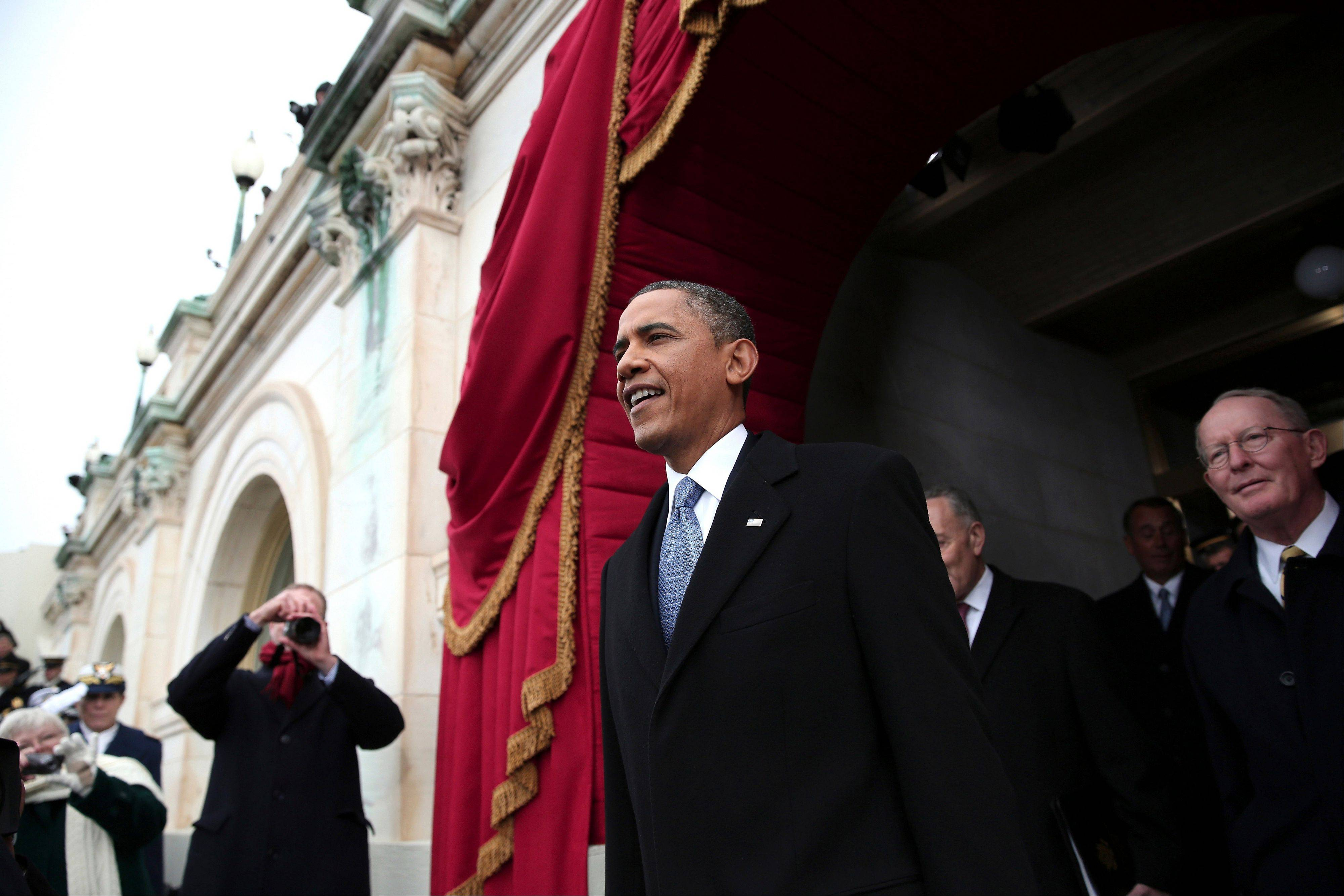 President Barack Obama arrives on the West Front of the Capitol in Washington, Monday.