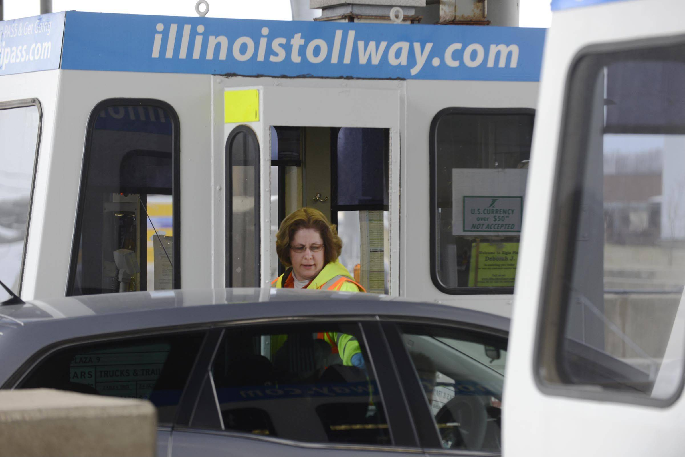 Toll Collector Debra Jacobson gives change to a customer at the Elgin plaza on the Jane Addams Tollway.