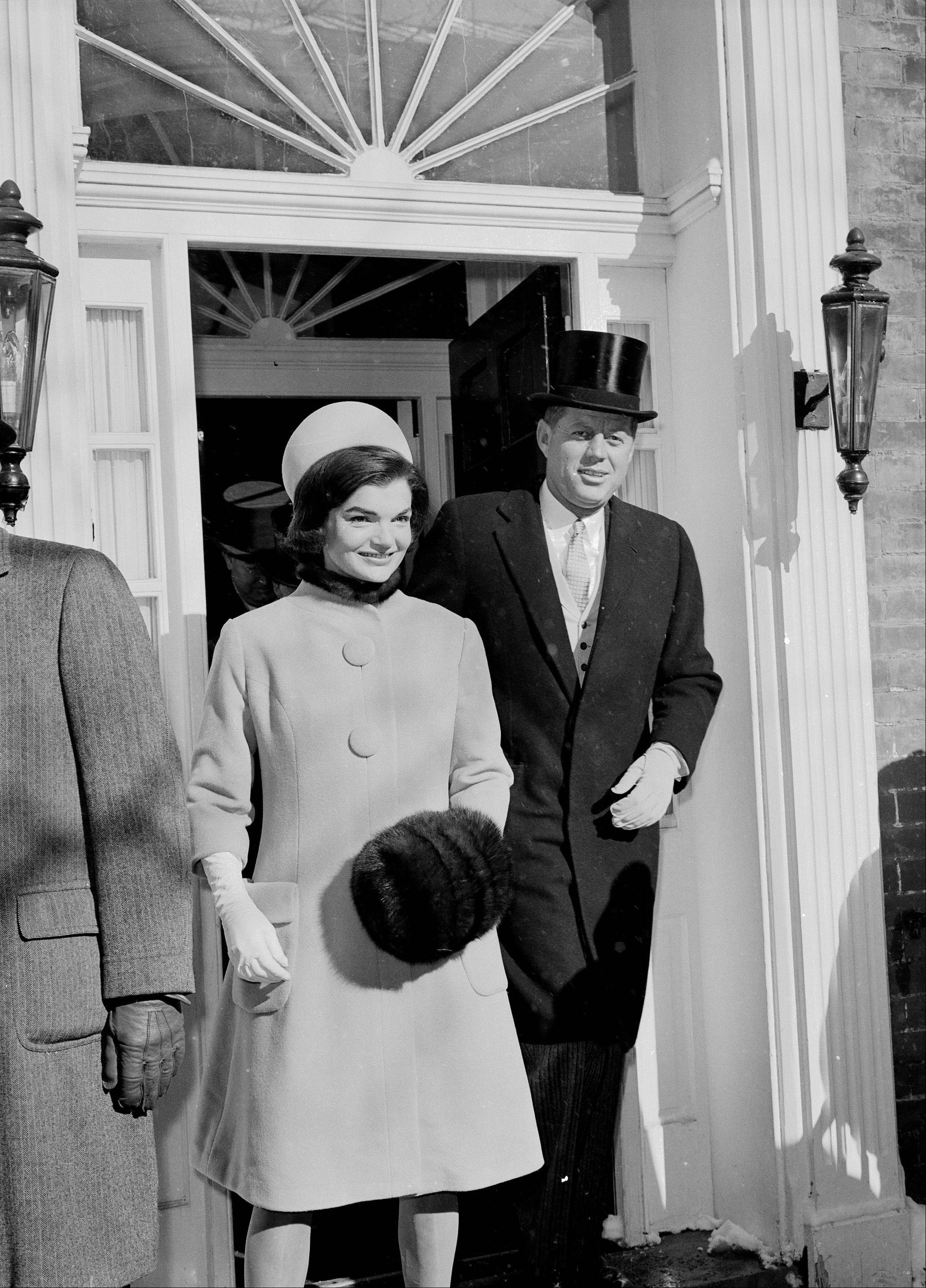 U.S. President-elect John F. Kennedy, wearing his high hat, and his wife, Jacqueline Kennedy, are shown as they leave their Georgetown resident for the inauguration day ceremonies in Washington, D.C., Jan. 20, 1961.