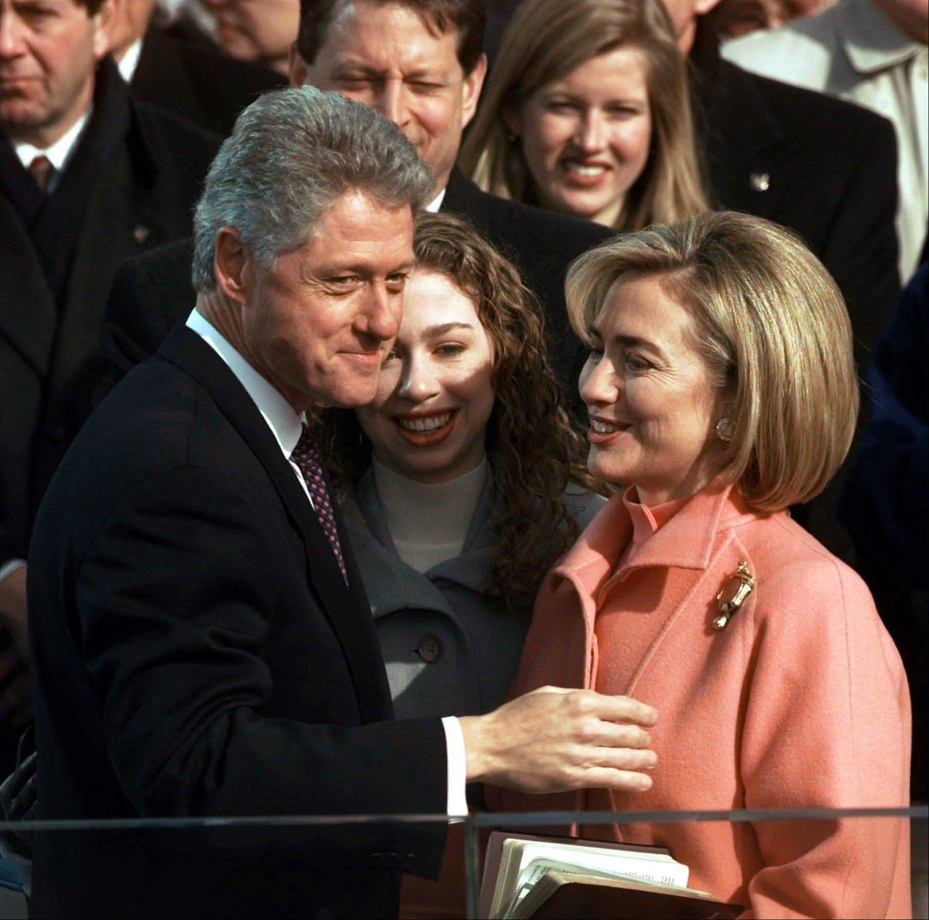 President Clinton, his daughter Chelsea and wife Hillary talk after Clinton was sworn in for his second term by Supreme Court Chief Justice William Rehnquist during the 53rd Presidential Inauguration Monday, Jan. 20, 1997, in Washington.