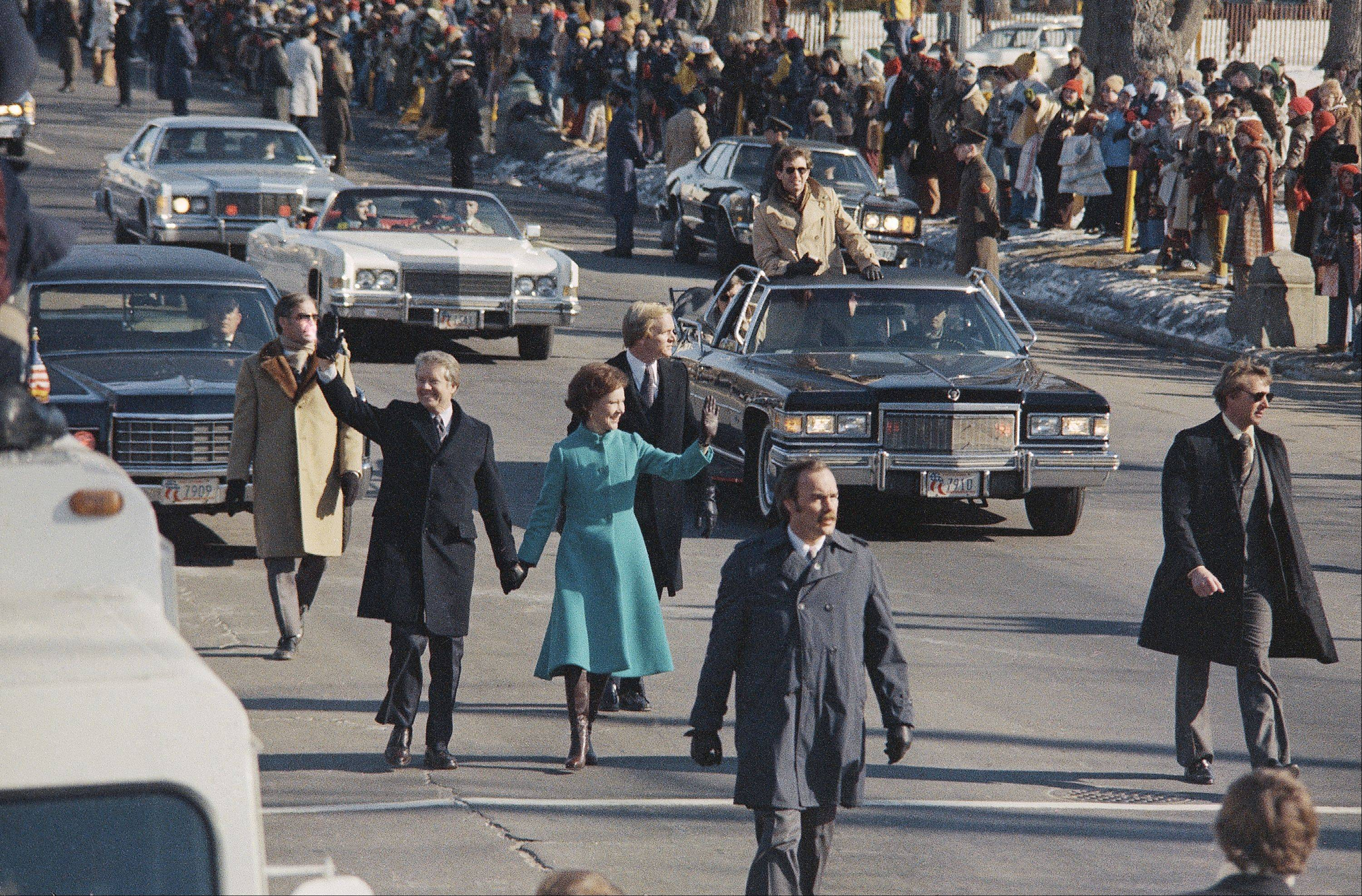 President Jimmy Carter and first lady Rosalynn Carter, center, walk down Pennsylvania Avenue in Washington, D.C., after Carter was sworn in as the nations 39th president on Jan. 20, 1977. Other members of the Carter family follow behind them.