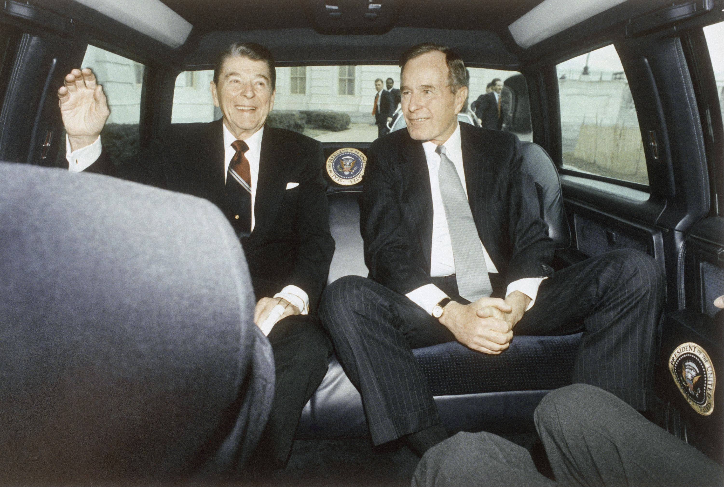 In this photo provided by the White House, President Ronald Reagan and President-elect George Bush arrive at the Capitol in Washington after a limousine ride from the White House for Bush's inaugural ceremonies, Jan. 21, 1989.
