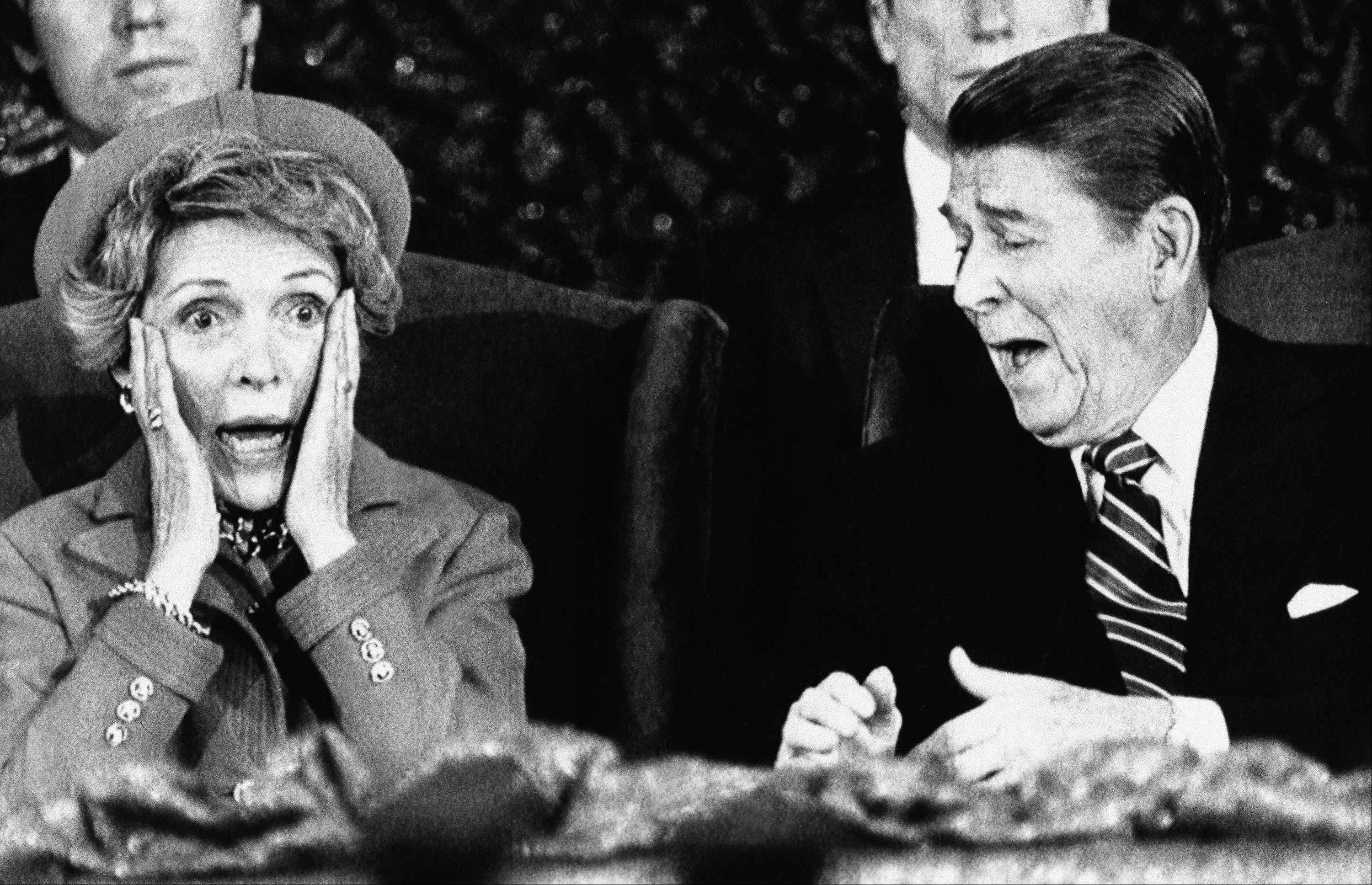 President Ronald Reagan and wife Nancy react after Mrs. Reagan sat down after speaking and forgot to introduce the President at the Capital Center in Landover, Md., Monday, Jan. 21, 1985, during an event held for those who would have participated in the inaugural parade, which was canceled because of bad weather.