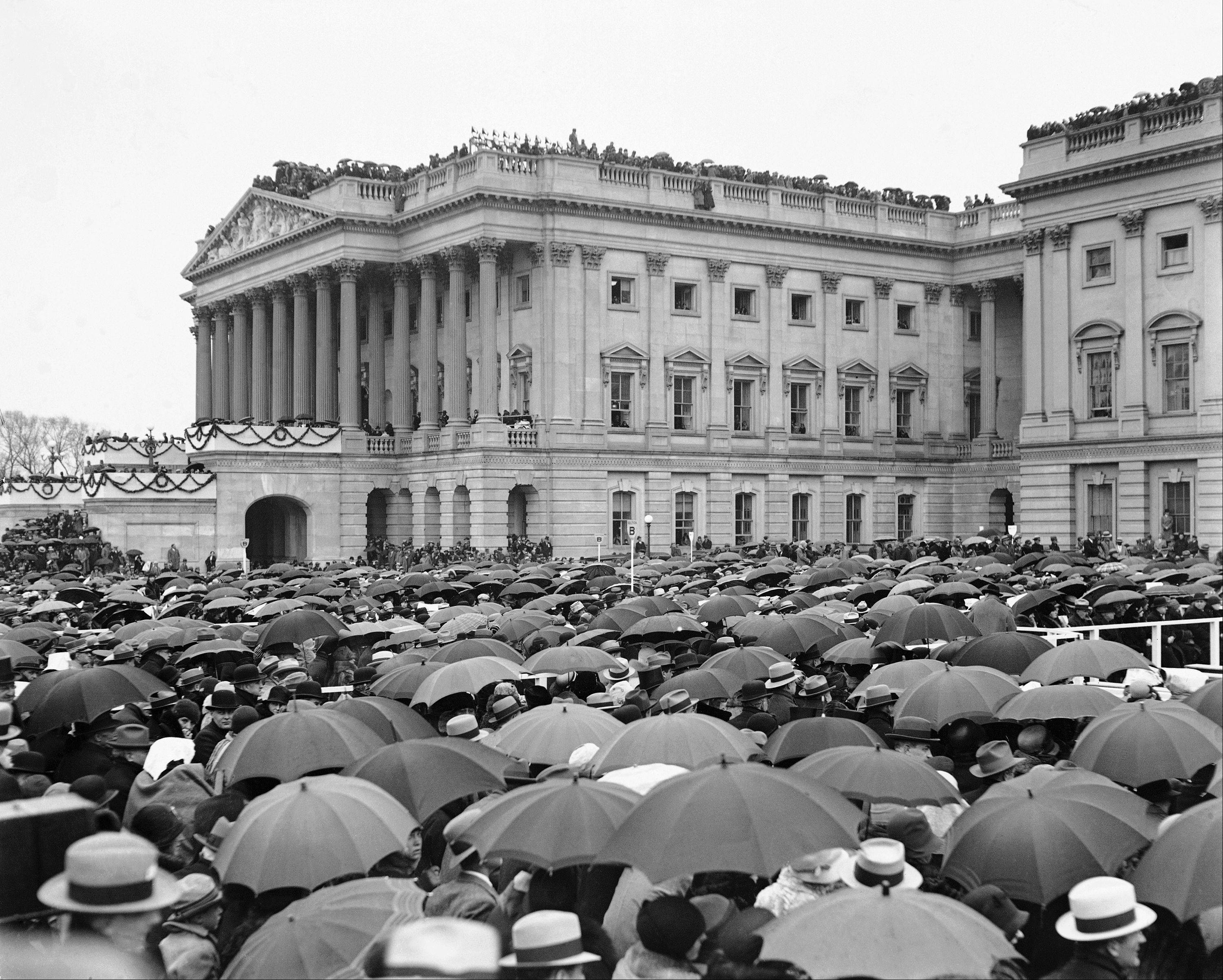 Crowds stand in the rain as they witness the inauguration of Herbert Hoover in Washington, D.C., March 4, 1929.