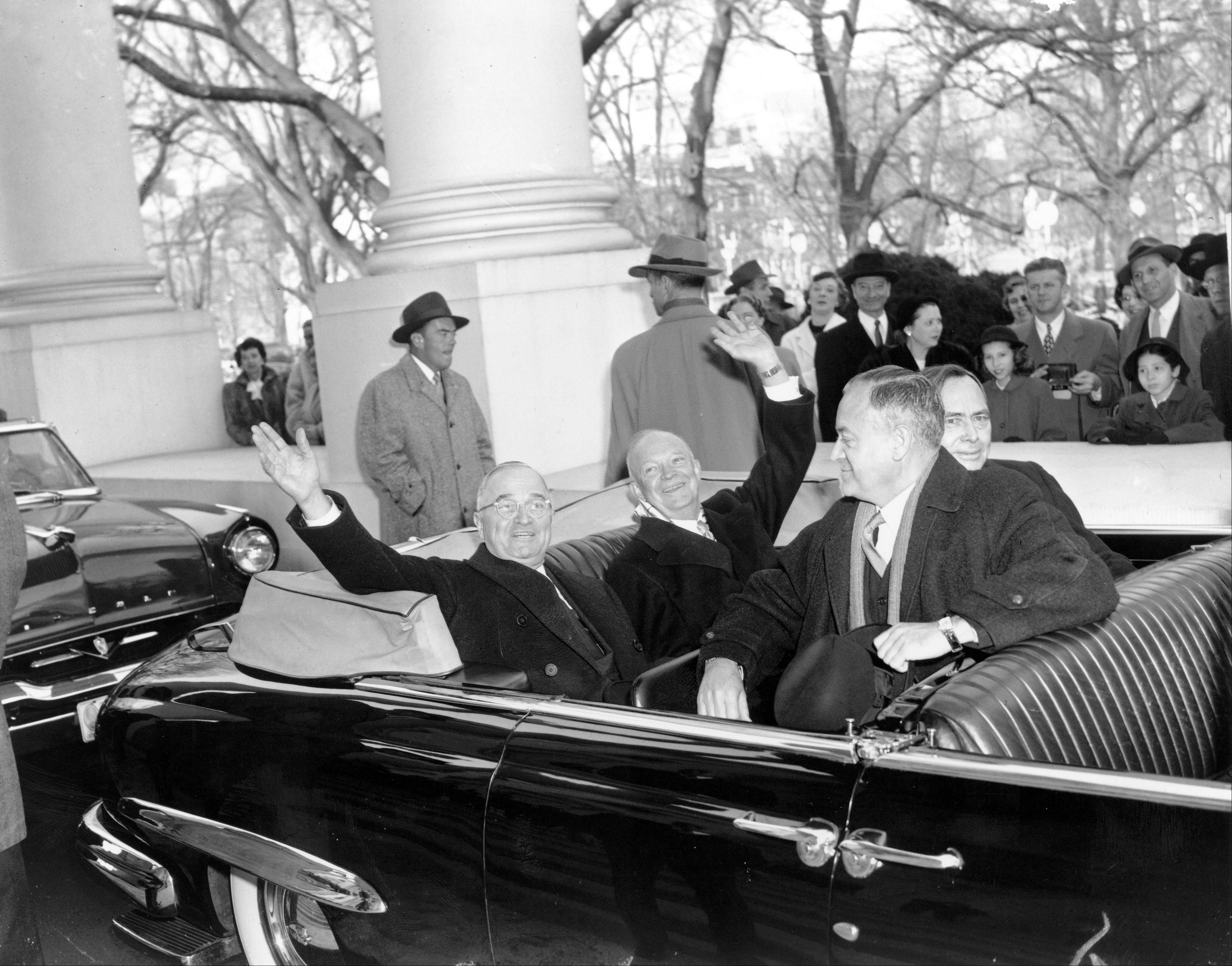 With smiles and a wave, U.S. President Harry Truman, left, and his successor, president-elect Dwight D. Eisenhower, leave the White House in an open car for inauguration ceremonies in Washington, D.C. on Jan. 20, 1953. Sitting in the front is Sen. Styles Bridges of New Hampshire, and behind him is House Speaker Joe Martin.