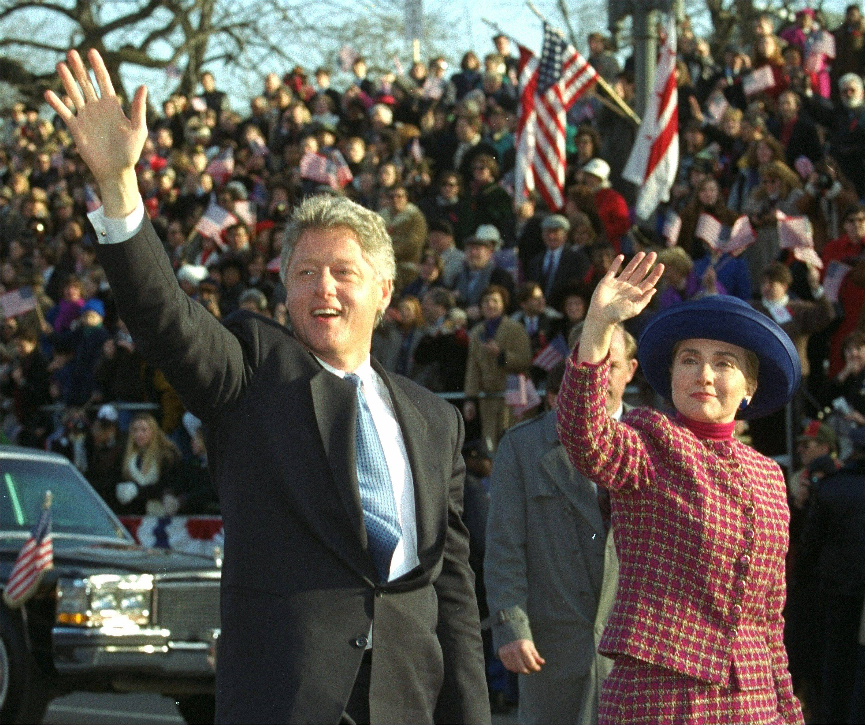 President and Mrs. Clinton wave as they walk down Pennsylvania Avenue in Washington Wednesday, January 20, 1993 during the presidential inaugural parade.