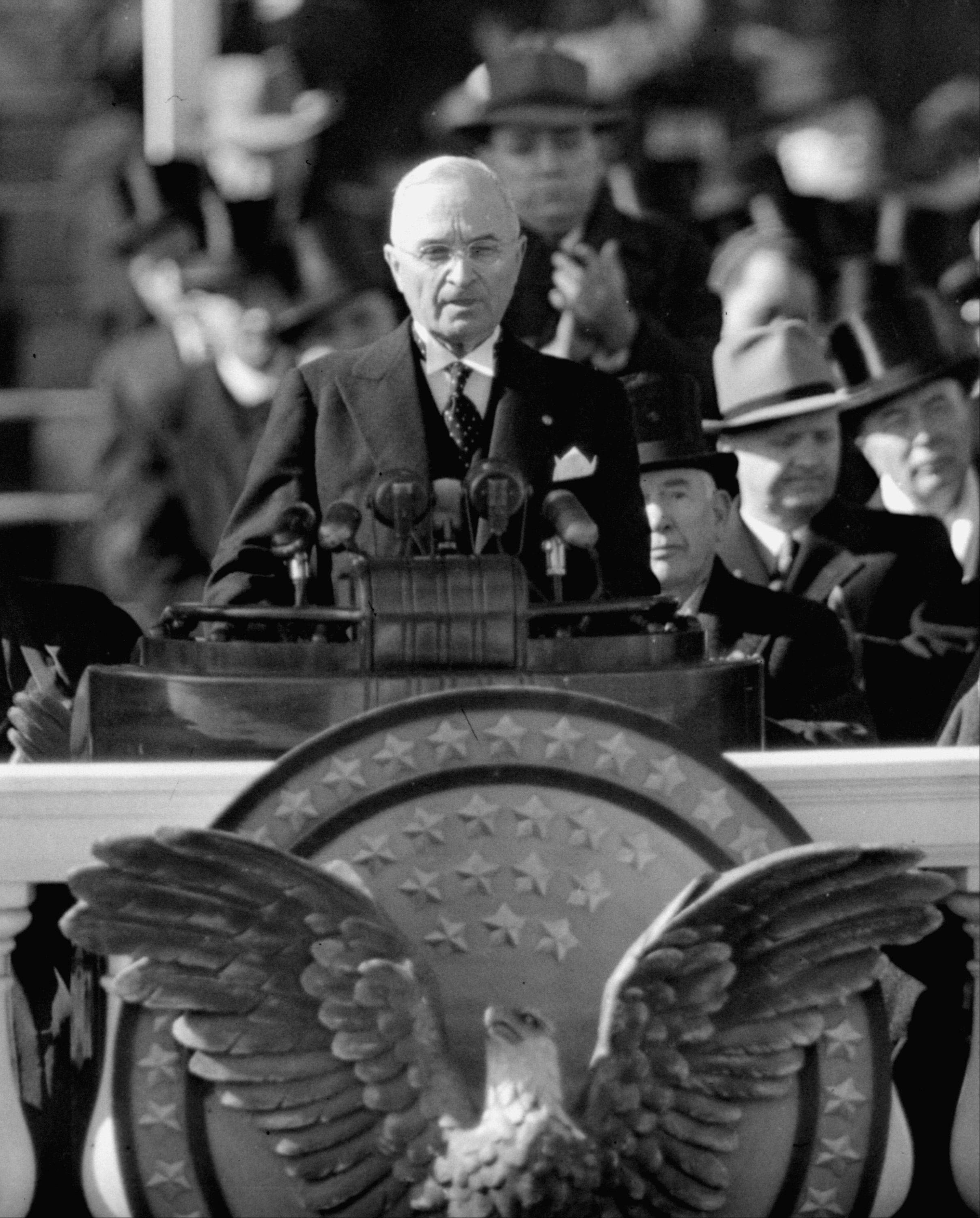 President Harry S. Truman delivers inaugural address from Capitol portico, January 20, 1949, after taking oath of office for his first full term as chief executive.