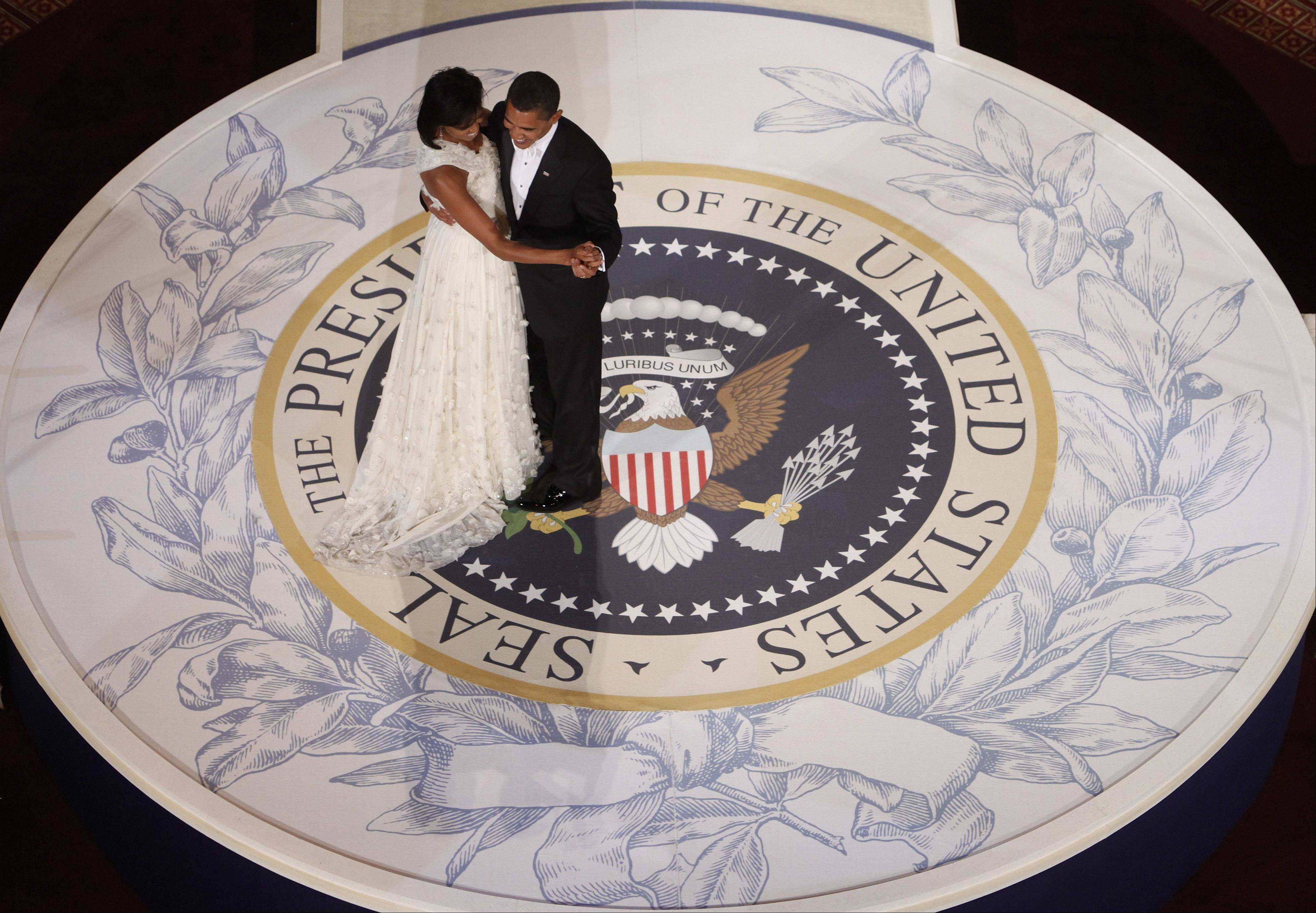 President Barack Obama and first lady Michelle Obama dance at the Commander in Chief Inaugural Ball at the National Building Museum in Washington, Tuesday, Jan. 20, 2009.