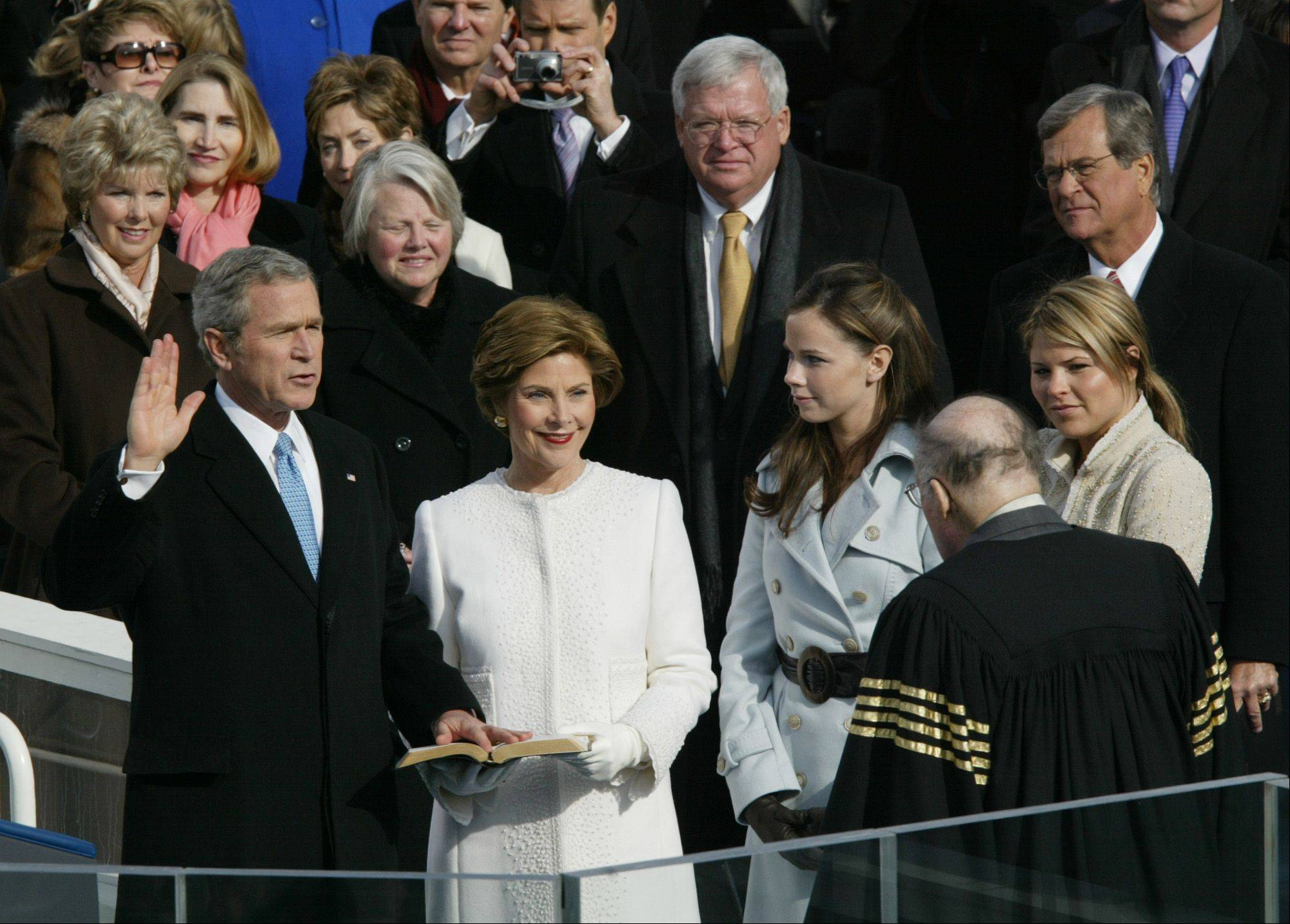 President Bush takes the oath of office from Chief Justice William Rehnquist, right, with first lady Laura Bush, and his daughters Barbara and Jenna at his side at the US Capitol in Washington, Jan. 20, 2005. In background are Speaker of the House Dennis Hastert, left, and Sen. Trent Lott, R-Miss.