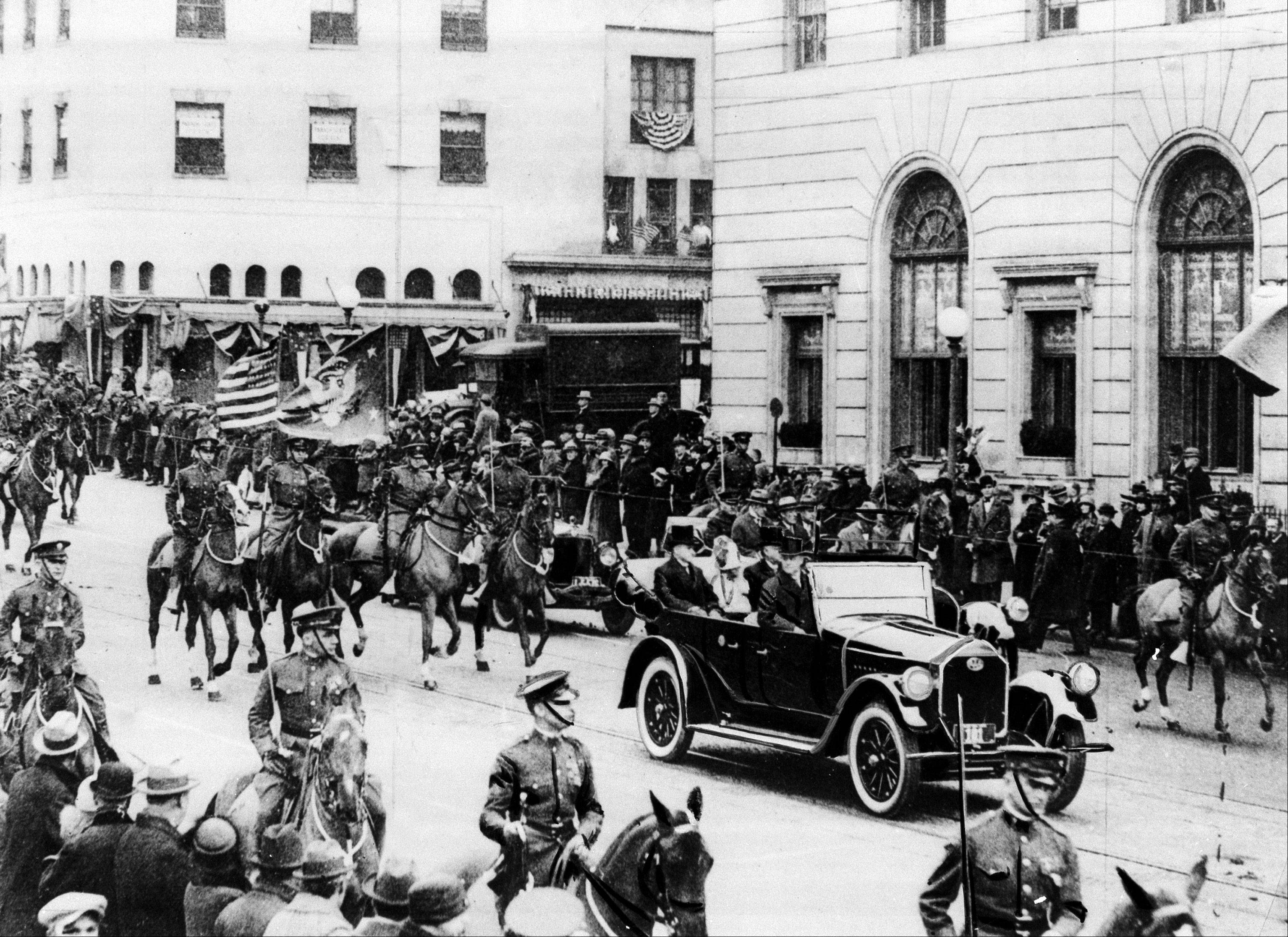 President Calvin Coolidge rides in an open car at the head of the inaugural parade with his wife Grace and Chief Justice Wiliam H. Taft in Washington, D.C., on March 4, 1925. Coolidge was sworn in as the 30th president of the United States.