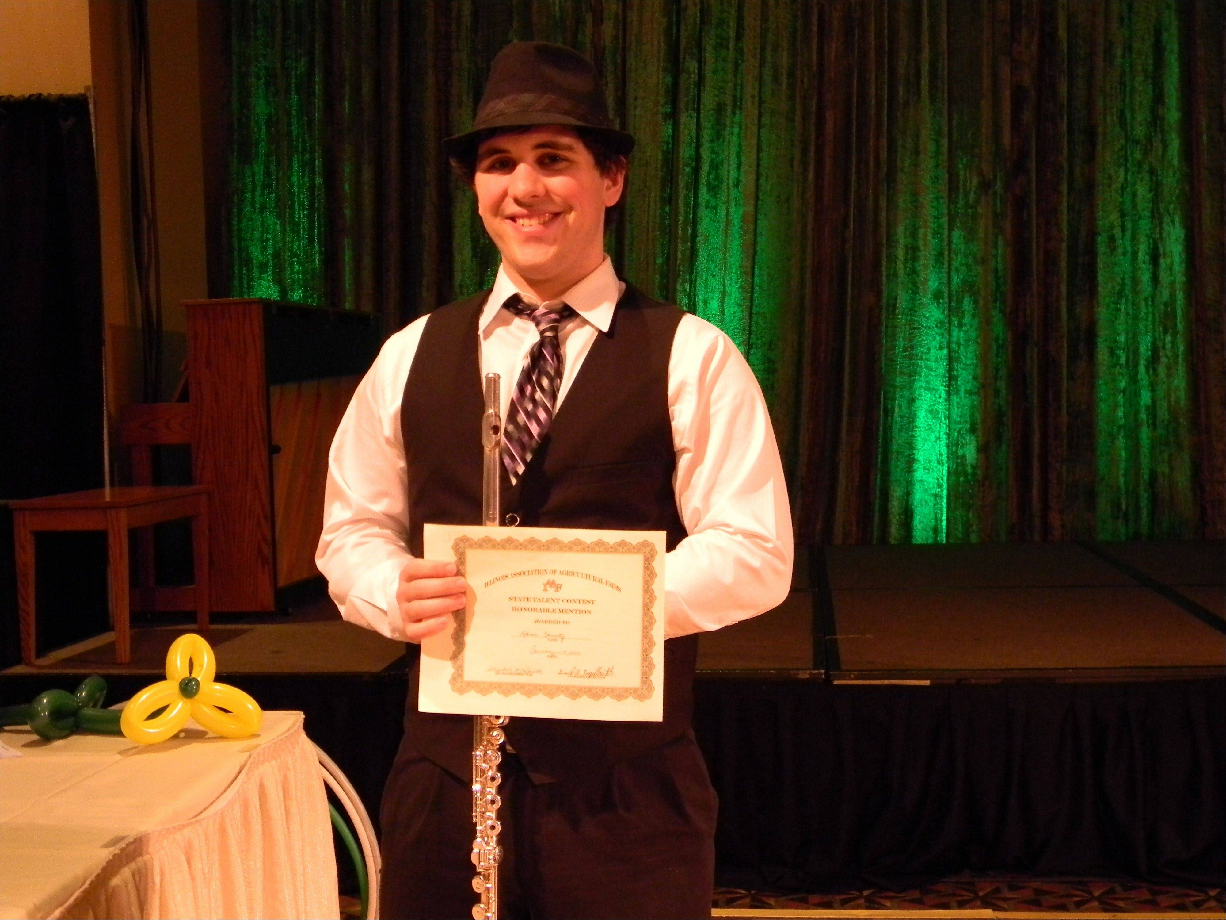 Eric Luminais, 19, of Geneva beat out 36 other acts in the Senior Division at the state talent competition.