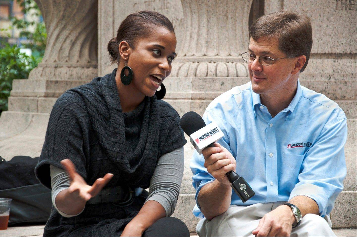 Mark Steber, right, interviews Justine Watson about the fiscal cliff in Madison Square Park for Jackson Hewitt�s Tax Bites video series last September in New York.