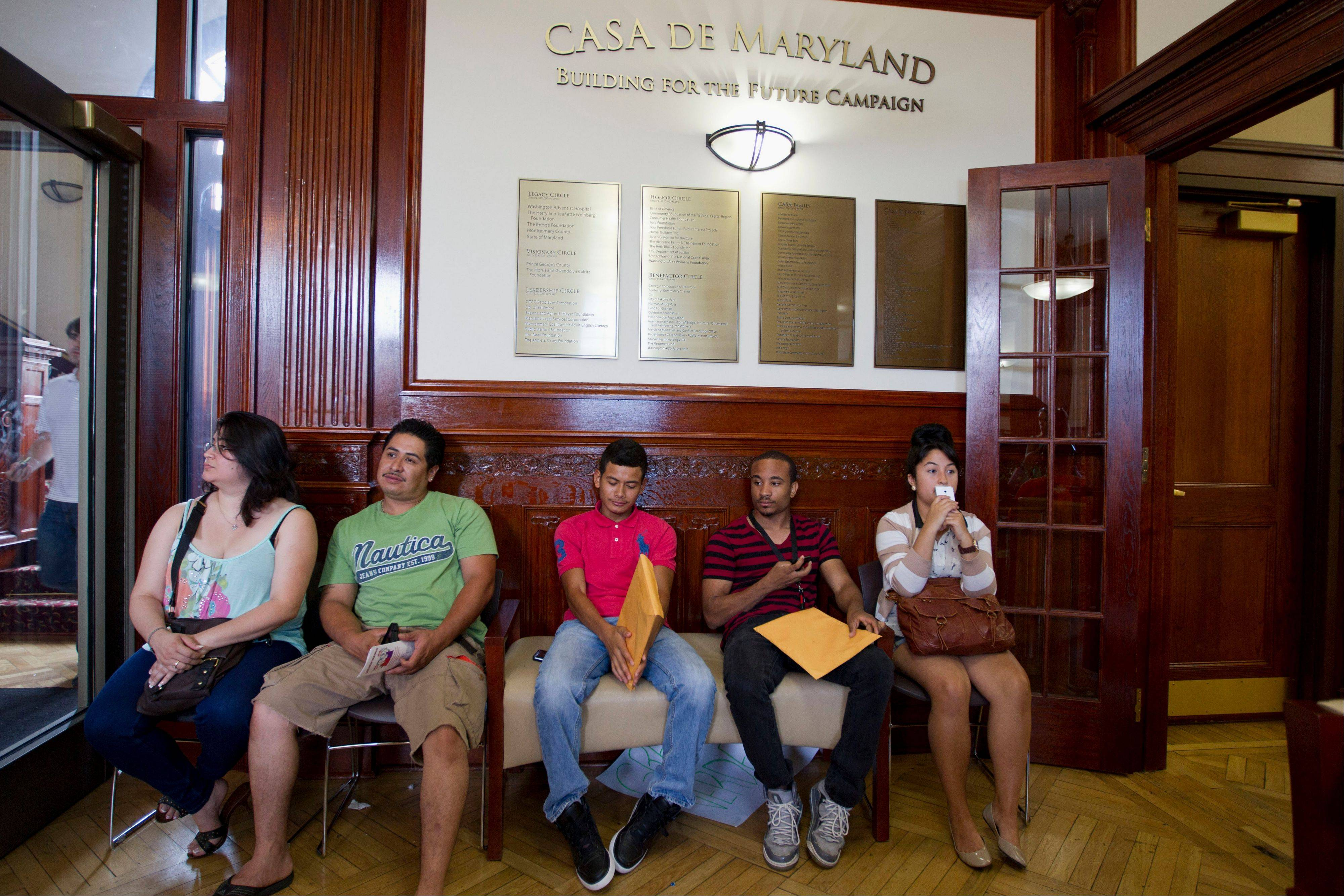 Applicants wait in Langley Park, Md., to apply for the Deferred Action Childhood Arrivals last Aug. 15, as the U.S. started accepting applications to allow immigrants to avoid deportation and get a work permit � but not a path to citizenship.