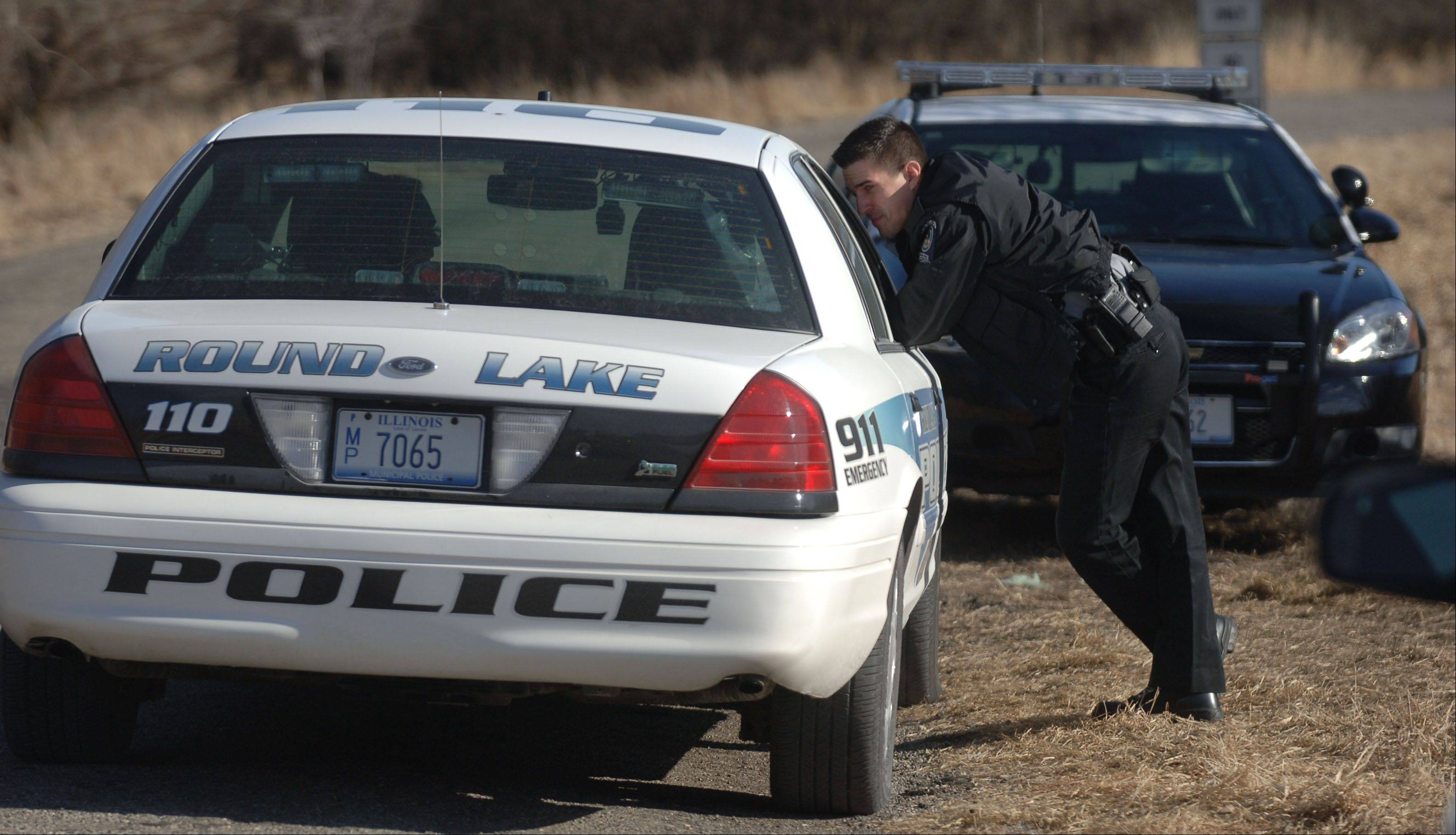 Police on the scene in Round Lake Park where the body of a 20-year-old Grayslake man was found Tuesday near Campbell Airport in Round Lake Park.