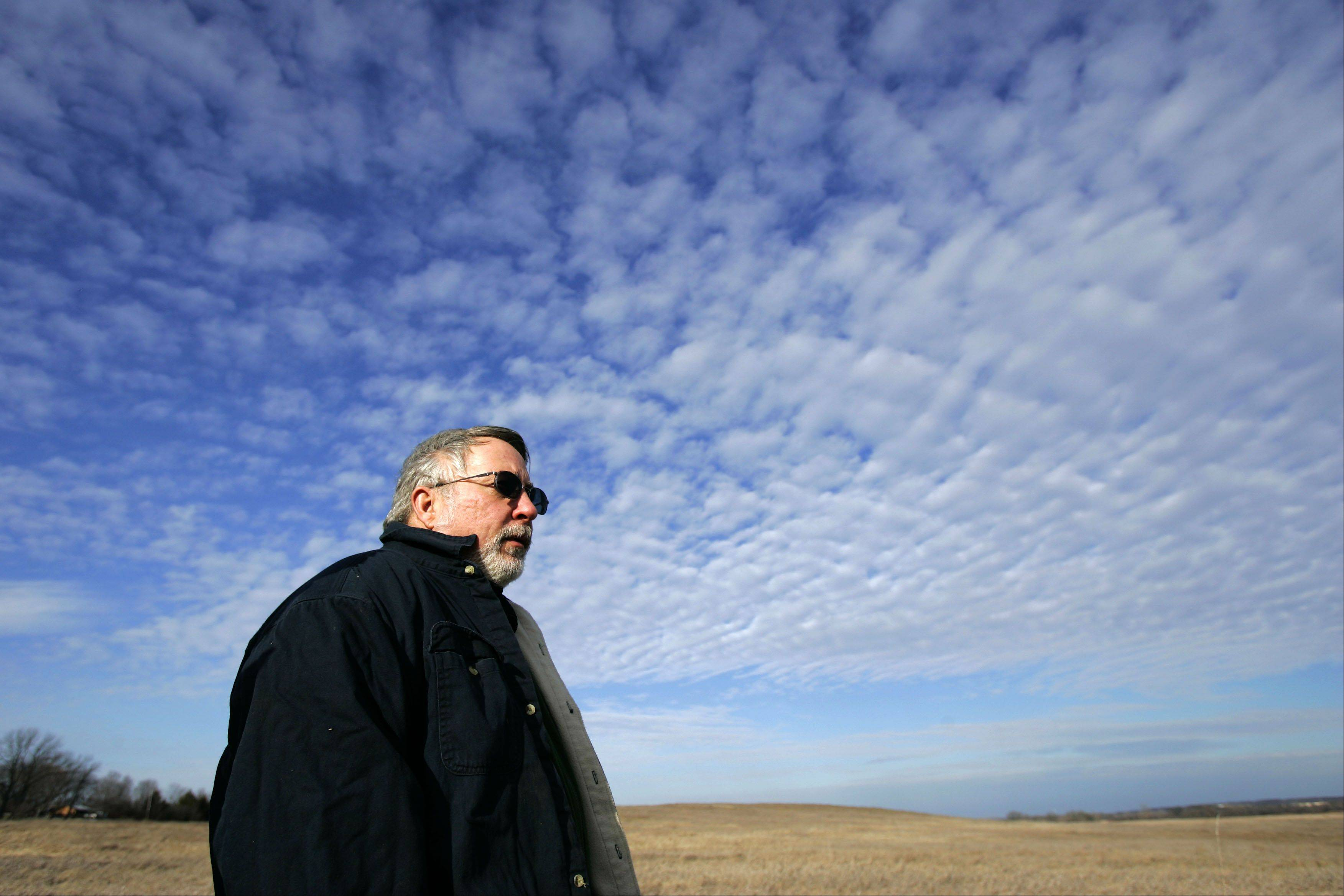 McHenry County Conservation District�s Ed Collins looks over part of Glacial Park.