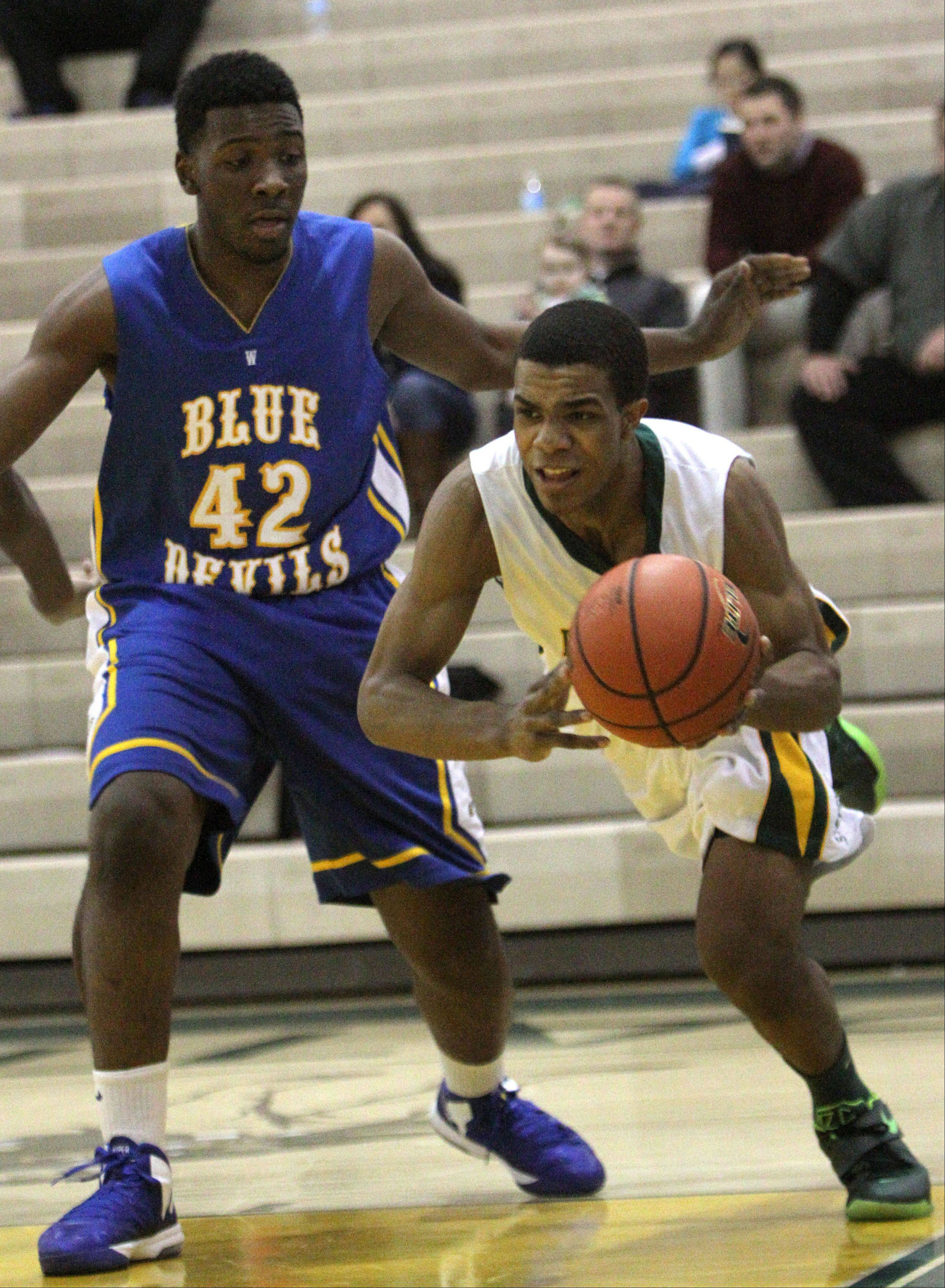 Stevenson's Connor Cashaw, right, drives on Warren's Dre Von Hill.