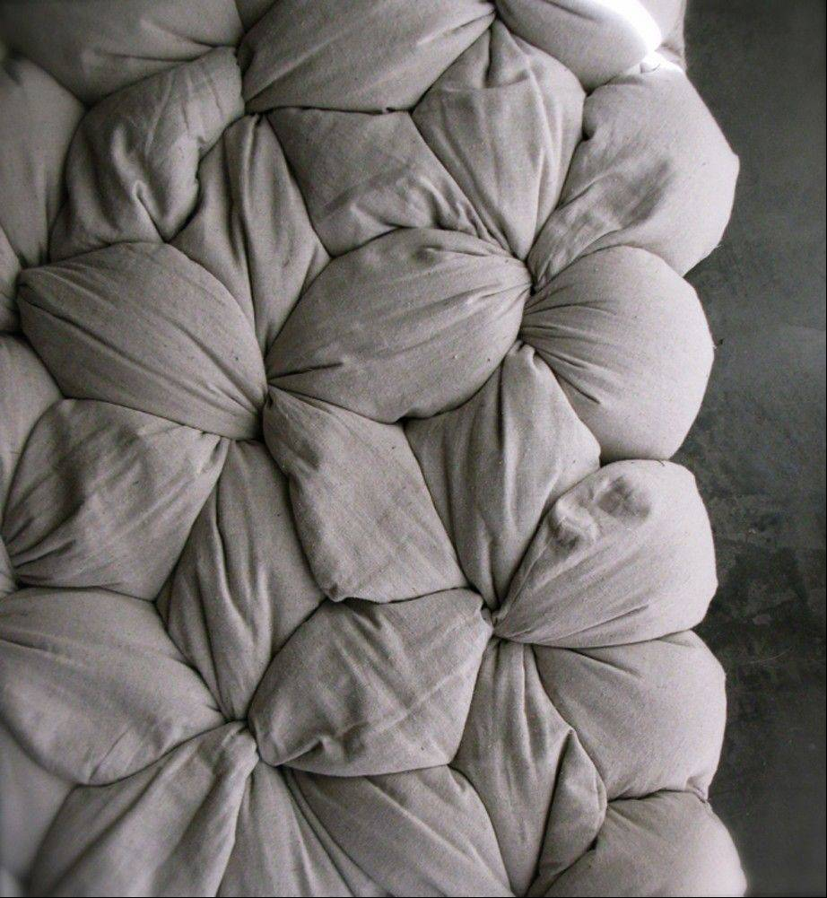 Detail of former interior designer Lynn Cimino's original Twist mattress design, where users assemble their own mattresses by stuffing buckwheat hulls into cotton covers.