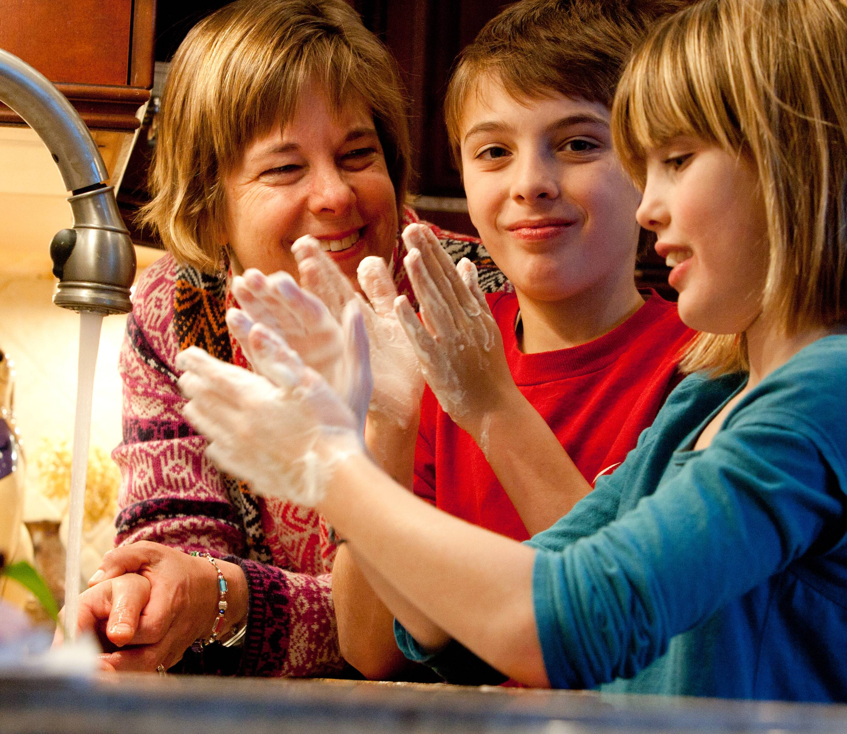 Dr. Karen Judy, a Glen Ellyn pediatrician, encourages germ-fighting hygiene with her children Thomas, 11, and Kate, 9.