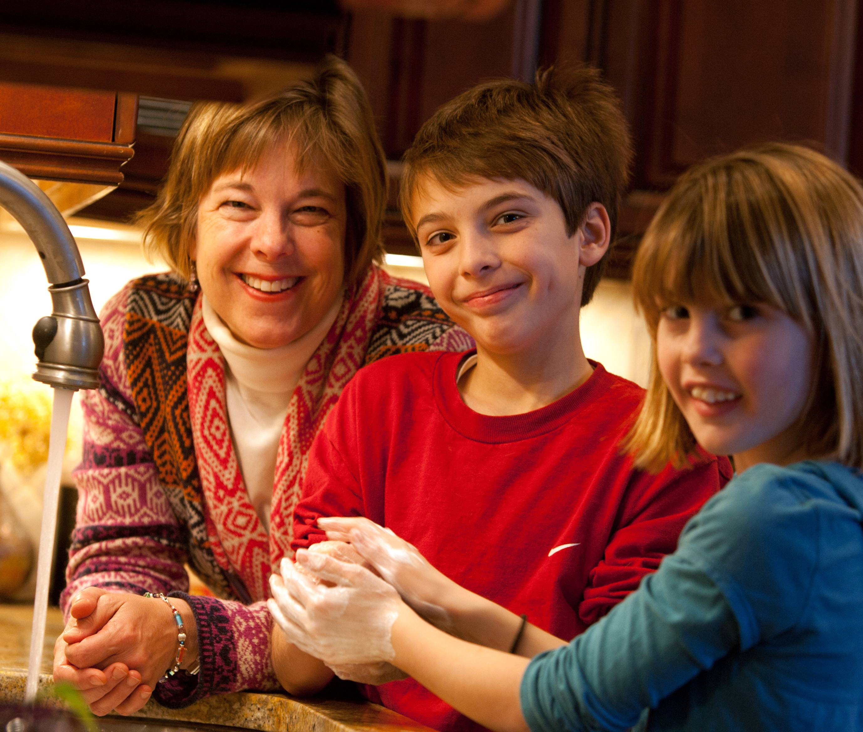 Dr. Karen Judy, a Glen Ellyn pediatrician, encourages germ fighting hygiene with her children Thomas, 11, and Kate, 9.