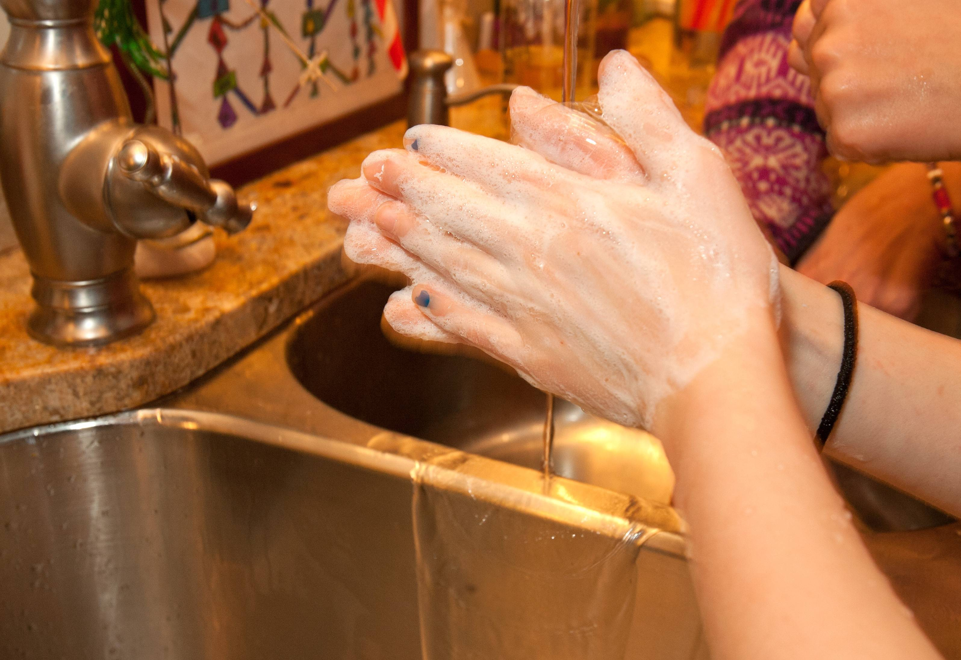 Washing hands, and keeping them under running water for 20 seconds, is a good way to sweep the germs away.