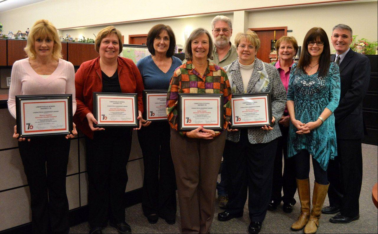 Libertyville District 70 teachers and staff selected six members of the Advocate Condell Medical Center to receive this year's Character Counts! award for service and leadership. Award winners holding the plaques are, from left, in back: Sherry Kobitter, Jody Siek-Georgacakis, Sharon Reich, and Thomas Roach, with District 70 teacher and Character Counts committee member Dale List and Superintendent Guy Schumacher; front row: Kathy Likosar, Raeann Fuller and District 70 art teacher Cindi Sartain.