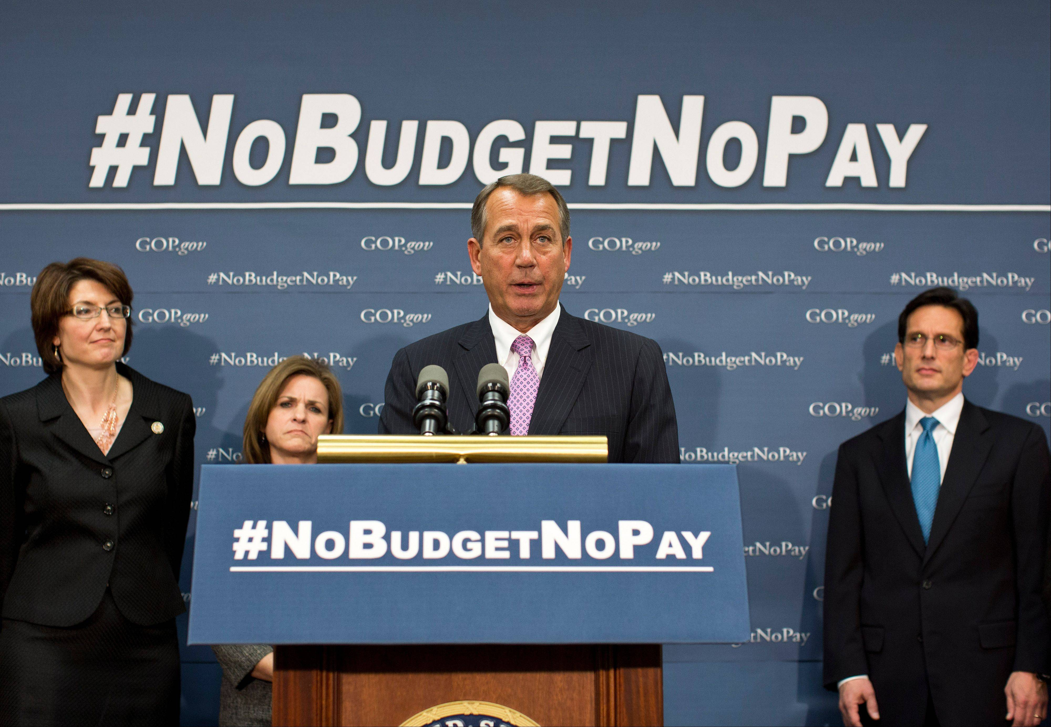 Speaker of the House John Boehner and the House GOP leadership speak to reporters after a closed-door meeting on avoiding a potential debt crisis, at the Capitol on Tuesday.