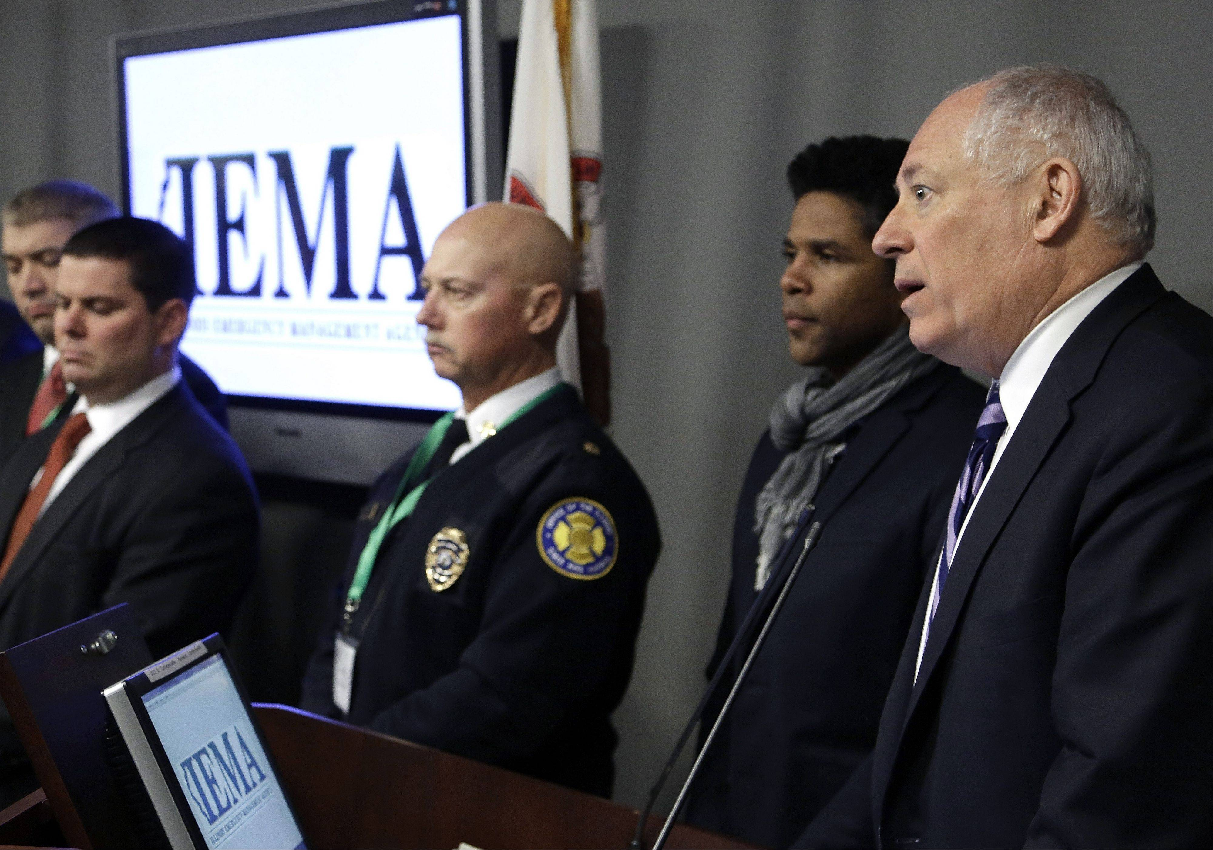 More than 50 people gathered Tuesday at the Illinois Emergency Management Agency in response to a call from Gov. Pat Quinn, right, following last month's Connecticut school shooting.